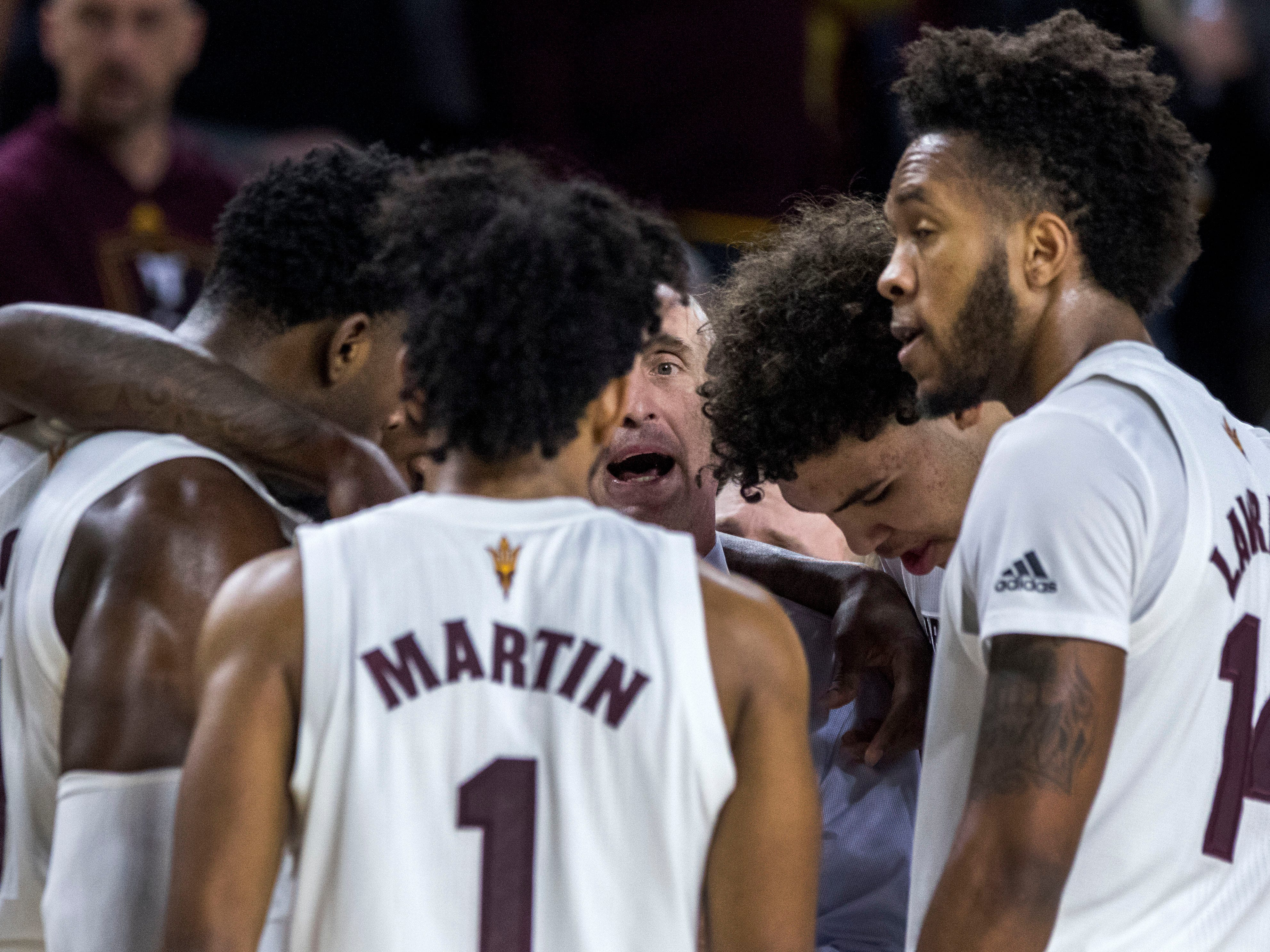 Arizona State coach Bobby Hurley huddles with his team during the second half against Oregon on Saturday, Jan. 19, 2019, in Tempe, Ariz. Arizona State won 78-64.(AP Photo/Darryl Webb)