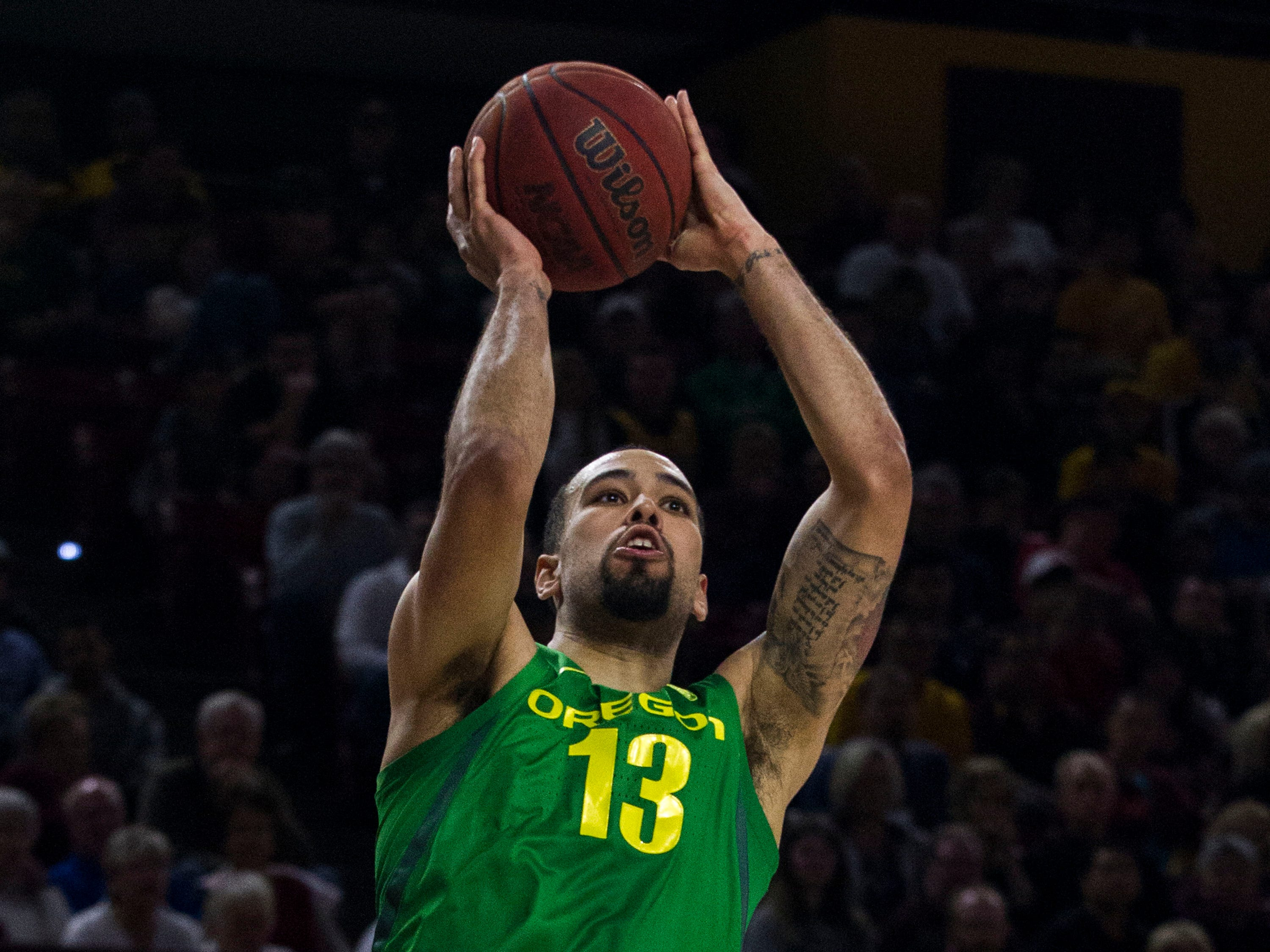 Oregon's Paul White (13) puts up a shot against Arizona State's Zylan Cheatham (45) during the first half, Saturday, Jan. 19, 2019, in Tempe, Ariz. (AP Photo/Darryl Webb)