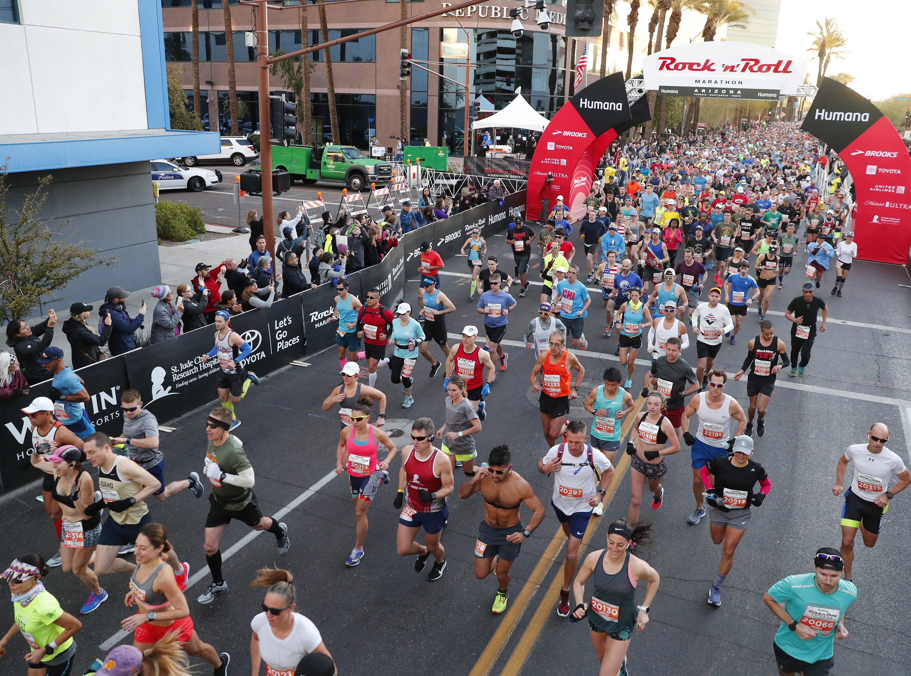 Runners start the Rock 'n' Roll Marathon in Phoenix, Jan. 20, 2019.