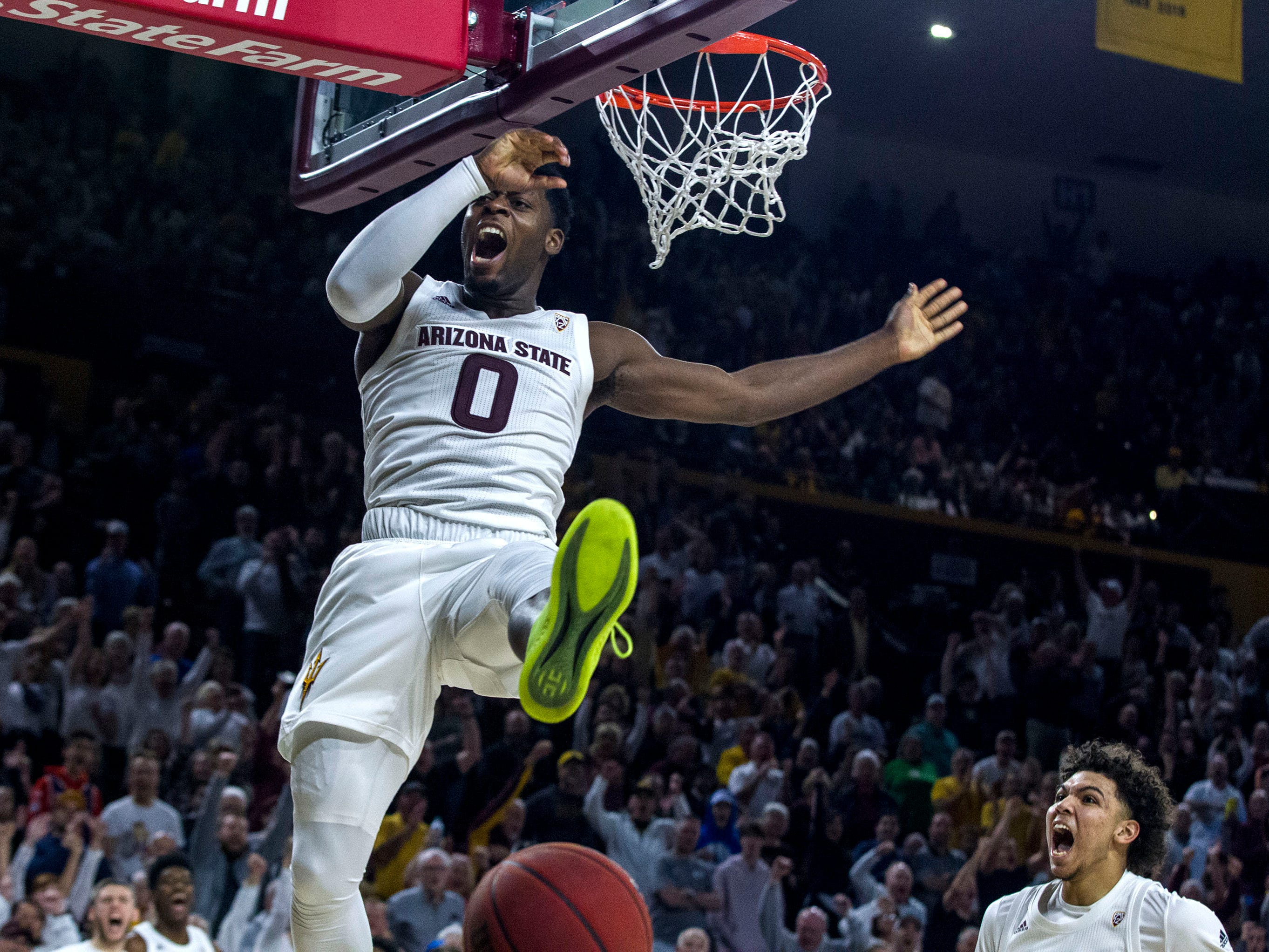 Arizona State's Taeshon Cherry, right, watches Luguentz Dort (0) hollers after a dunk against Oregon during the second half, Saturday, Jan. 19, 2019, in Tempe, Ariz. Arizona State won 78-64. (AP Photo/Darryl Webb)