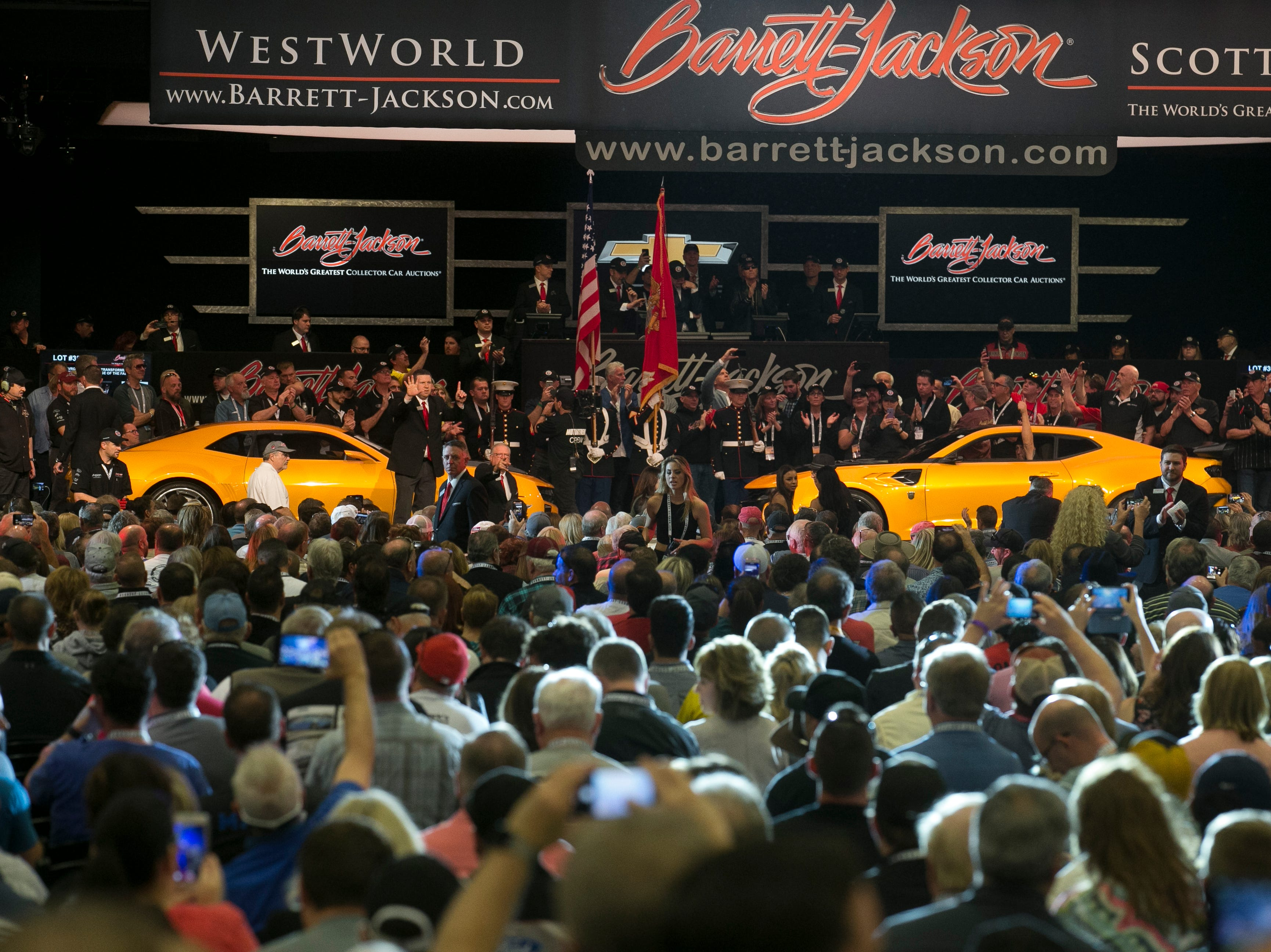 Four original Bumblebee Camaros from the Transformers film franchise sit on the auction block at Barrett-Jackson collector-car auction at WestWorld on Jan. 19, 2019, in Scottsdale. The four sold for $500,000 total with the money going to benefit Operation Homefront, a non-profit that supports military families.