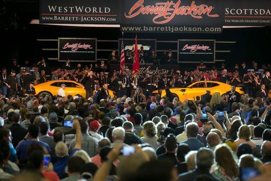 Four original Bumblebee Camaros from the Transformers film franchise sit on the auction block at Barrett-Jackson collector-car auction at WestWorld on Jan. 19, 2019, in Scottsdale.