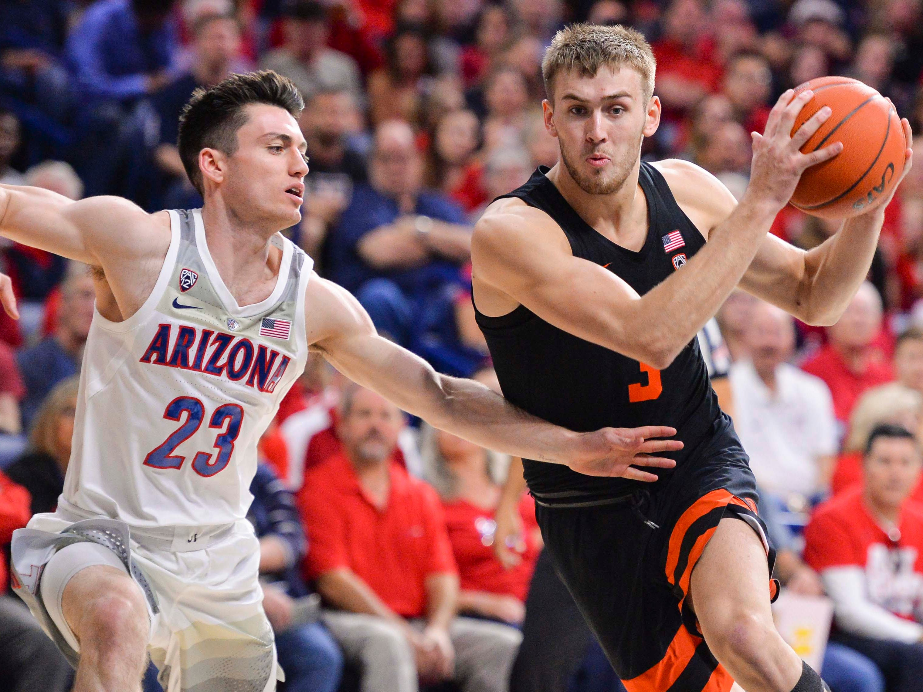 Jan 19, 2019; Tucson, AZ, USA; Arizona Wildcats guard Alex Barcello (23) defends Oregon State Beavers forward Tres Tinkle (3) during the first half at McKale Center. Mandatory Credit: Casey Sapio-USA TODAY Sports