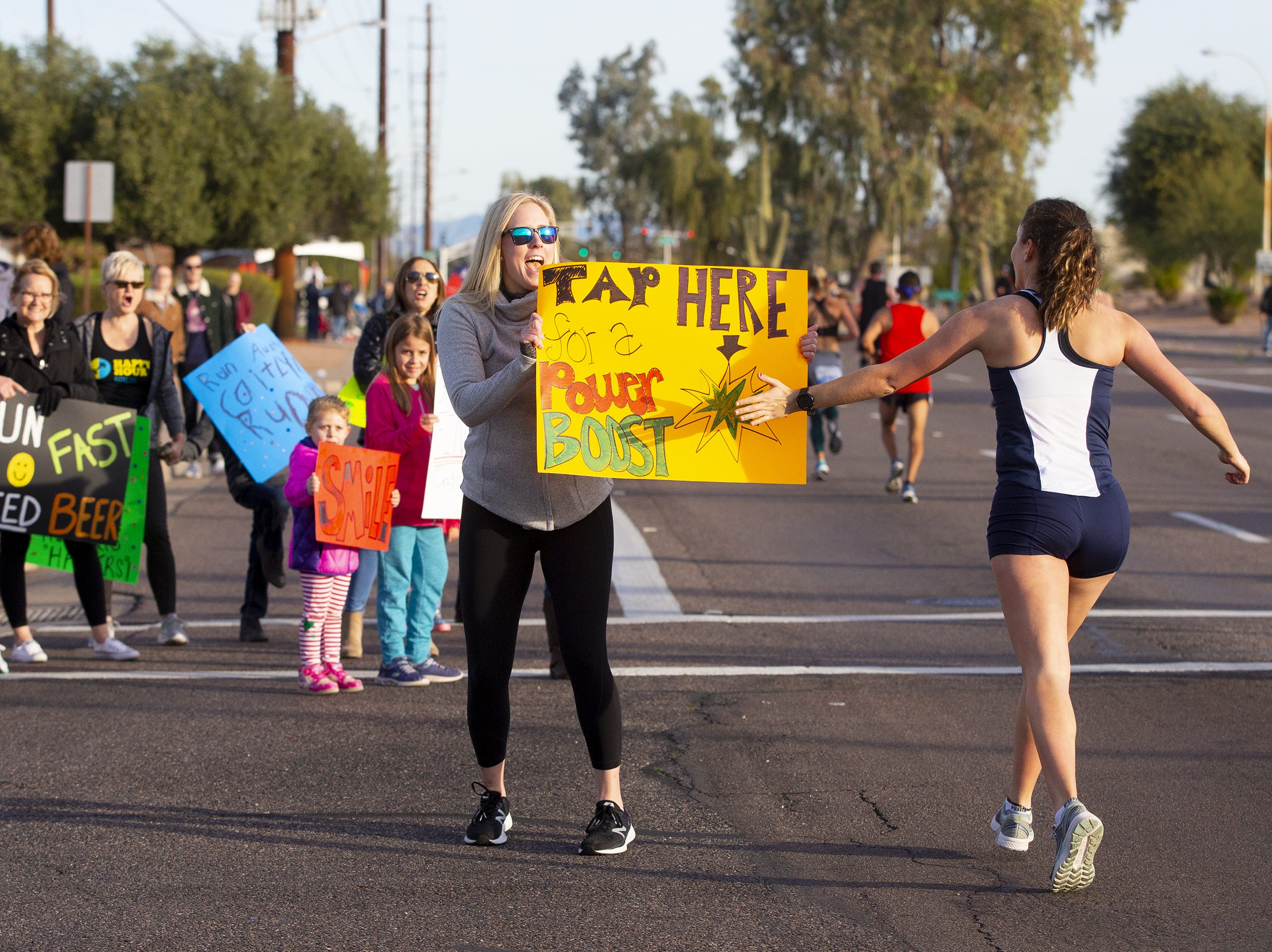 Shelby Mobley of Chandler offers the runners a boost during the Humana Rock 'N' Roll half marathon on Jan. 20, 2019.
