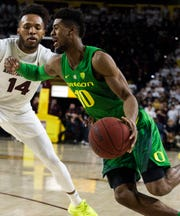 Oregon's Victor Bailey Jr. (10) drives around Arizona State's Kimani Lawrence (14) during the first half, Jan. 19, 2019, in Tempe, Ariz. (AP Photo/Darryl Webb)