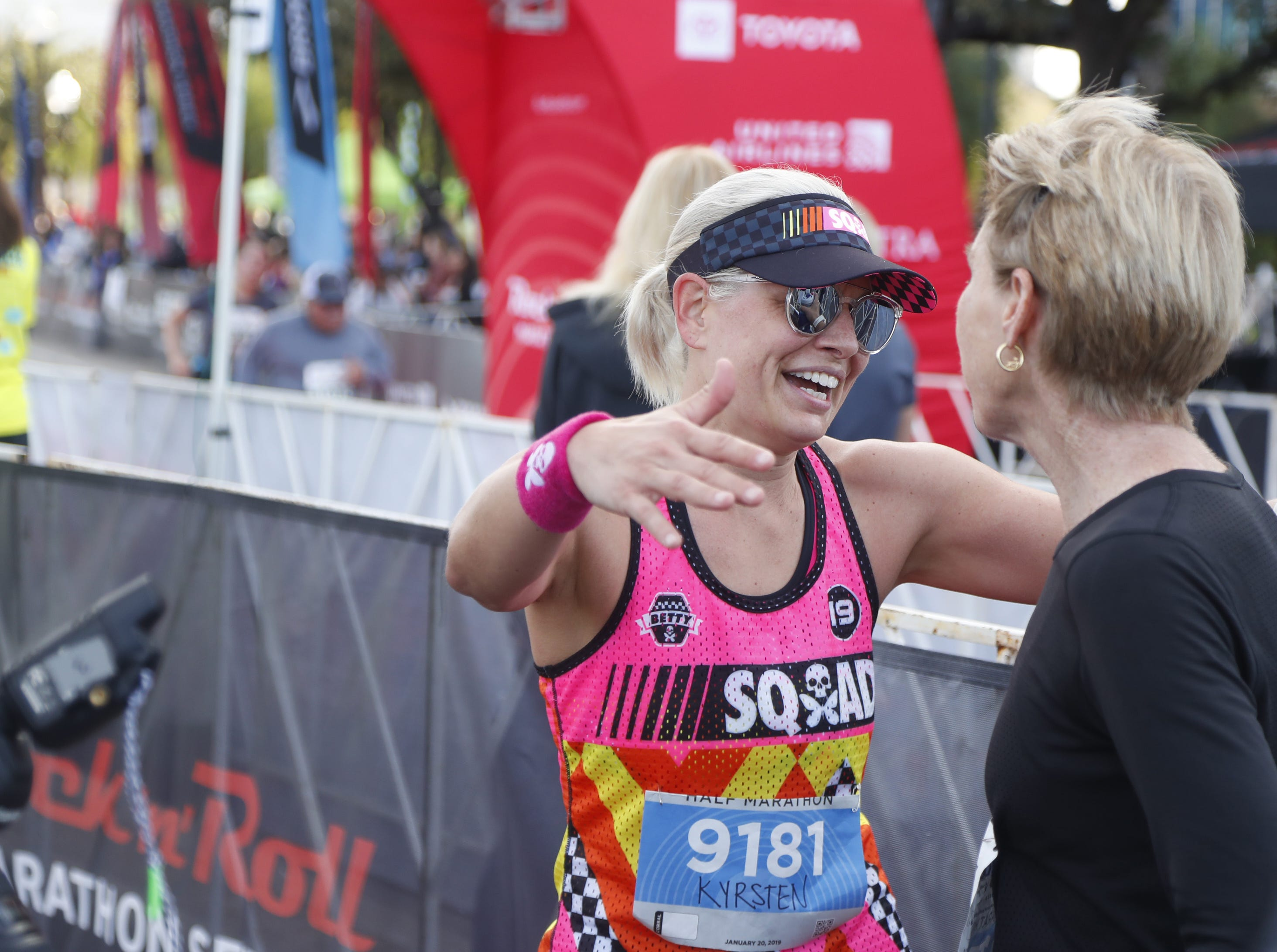 Sen. Kyrsten Sinema hugs Paula Newby-Fraser after Sinema finished the Rock 'N' Roll half-marathon in Tempe on Jan. 20, 2019.