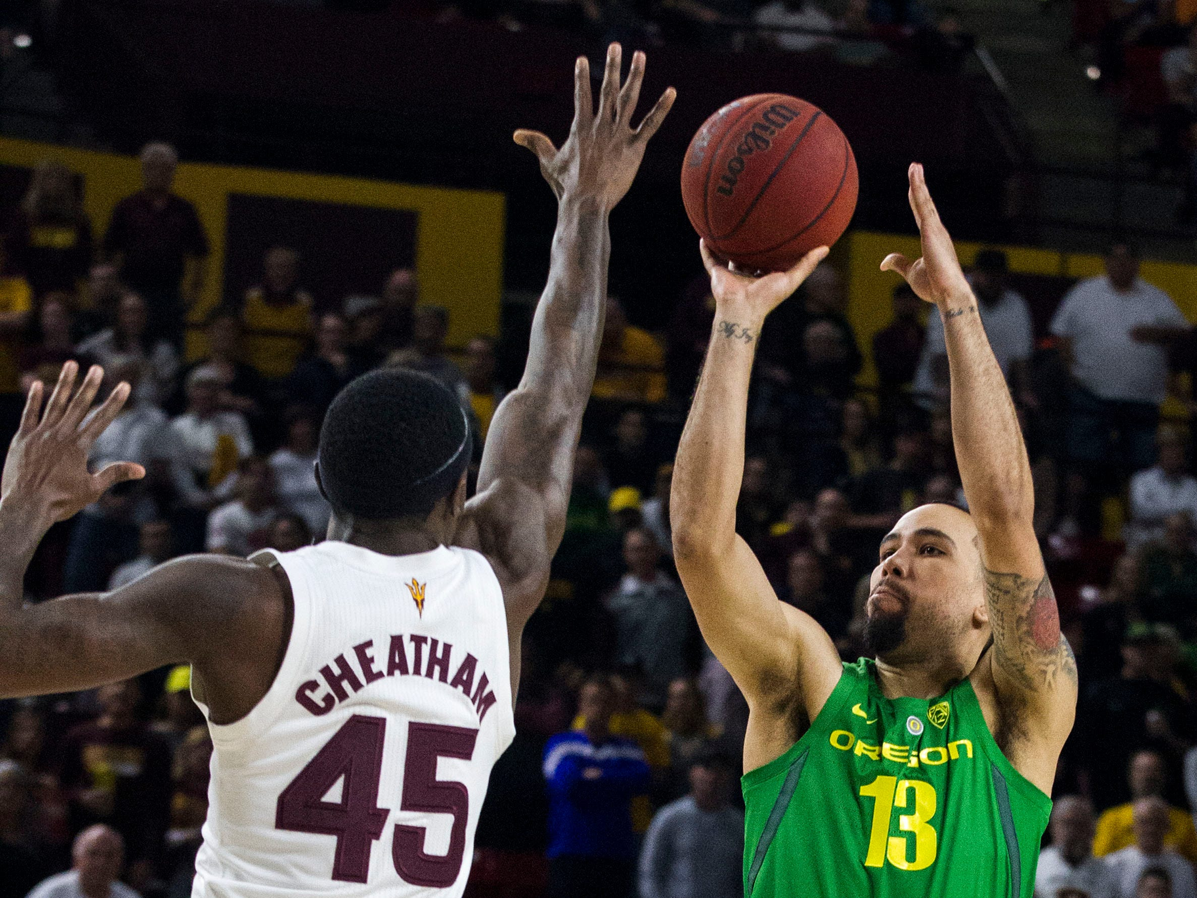Oregon's Paul White (13) shoots over Arizona State's Zylan Cheatham (45) during the first half, Saturday, Jan. 19, 2019, in Tempe, Ariz. (AP Photo/Darryl Webb)