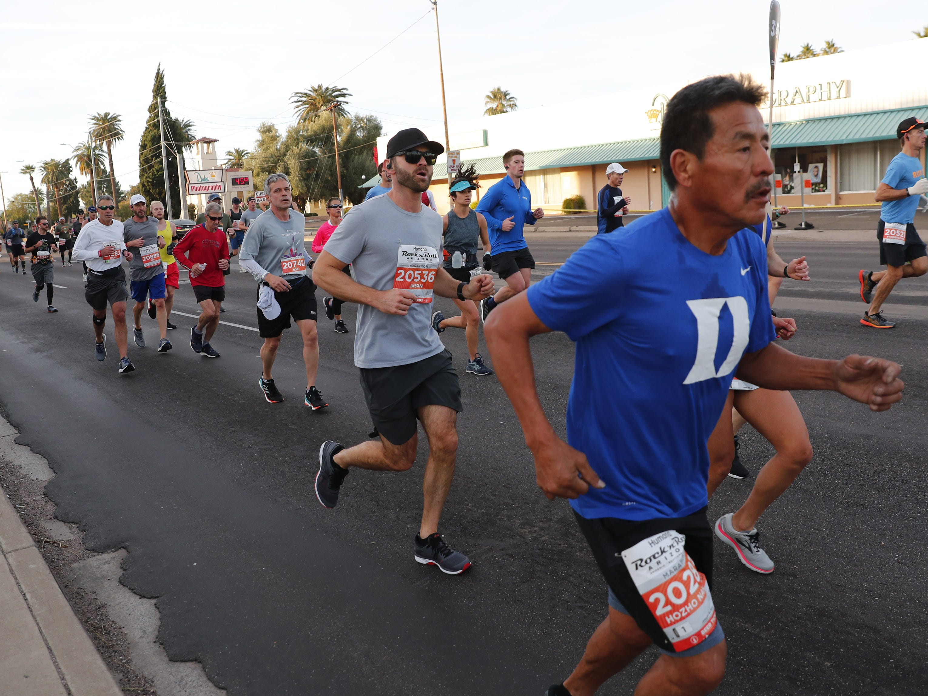 Runners make their way on 7th Ave. during the Rock 'n' Roll Marathon in Phoenix, Jan. 20, 2019.