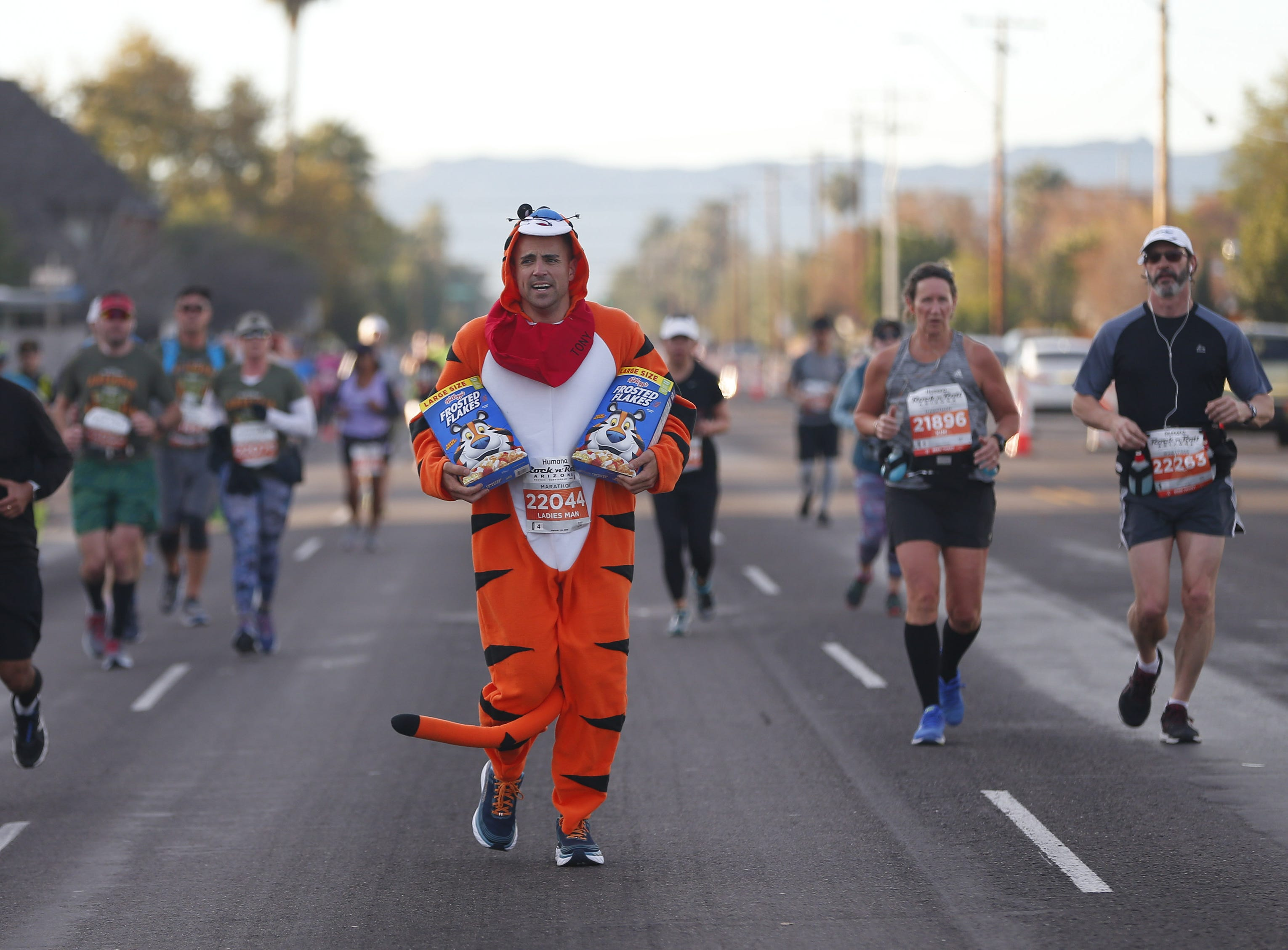 Sam Goldberg runs as the Frosted Flakes cereal mascot during the Rock 'n' Roll Marathon in Phoenix, Jan. 20, 2019.
