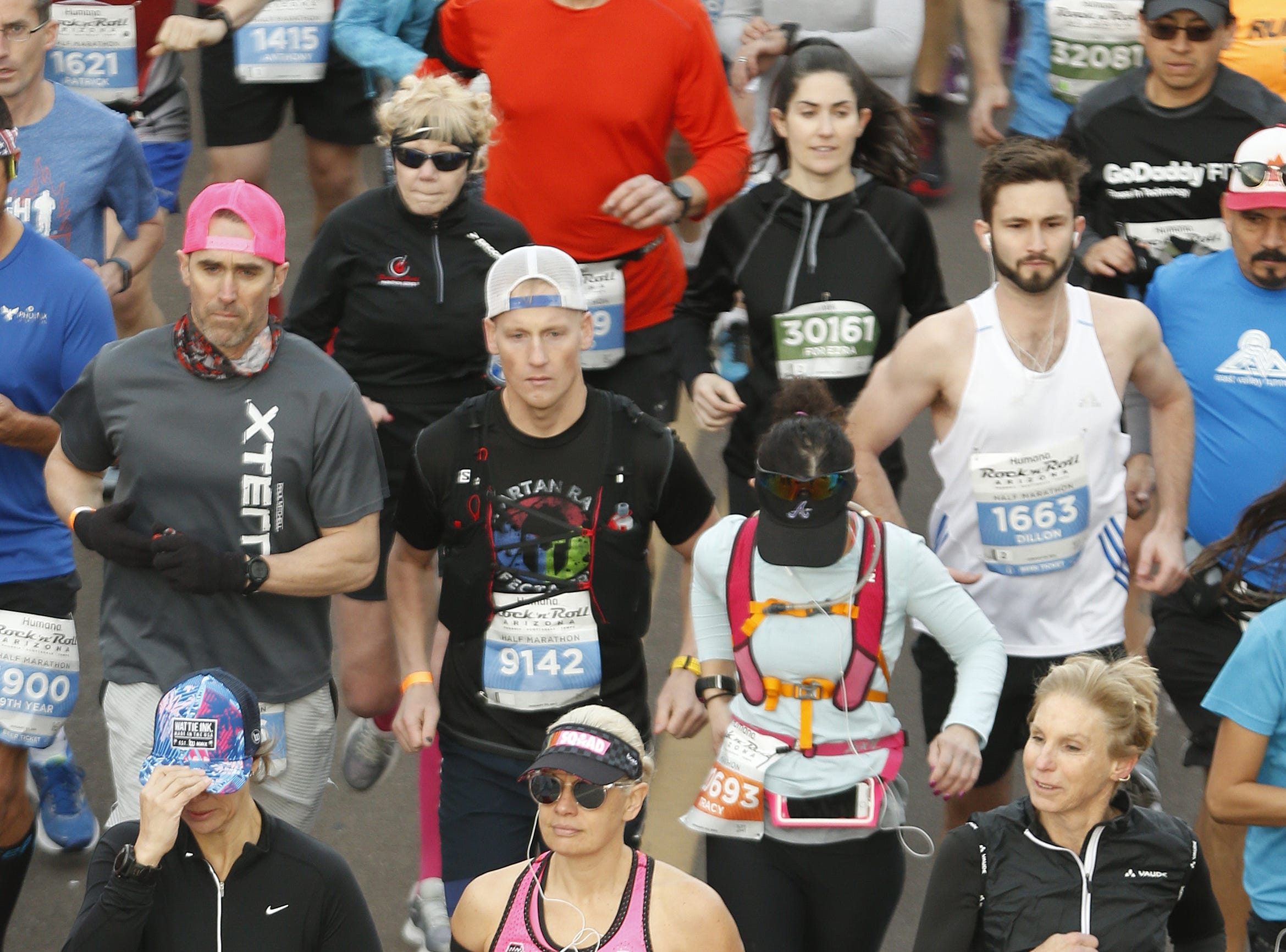 Sen. Kyrsten Sinema (in pink) takes off with others on their way during the Rock 'N' Roll half-marathon in Tempe on Jan. 20, 2019.