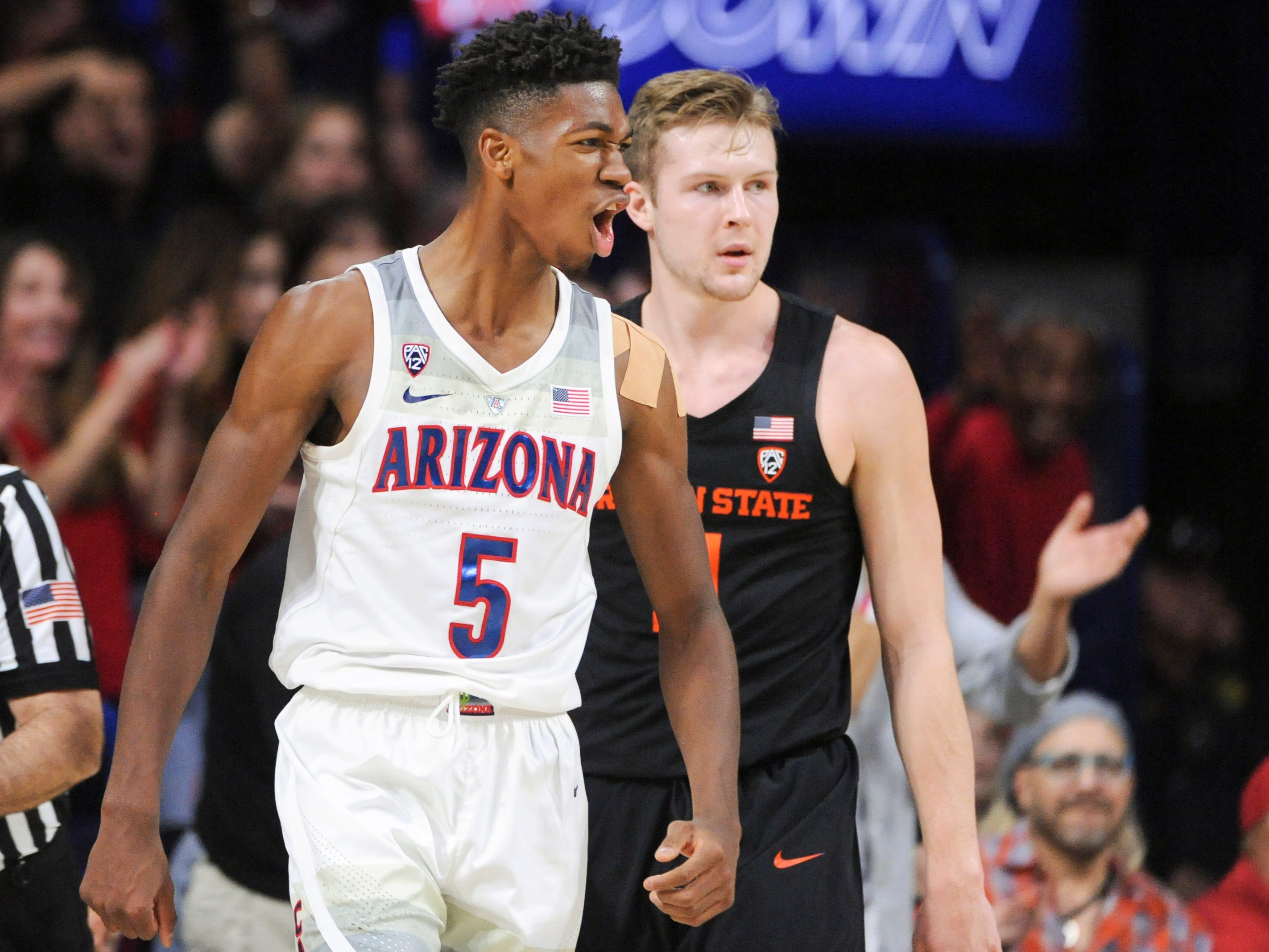 Jan 19, 2019; Tucson, AZ, USA; Arizona Wildcats guard Brandon Randolph (5) reacts to a foul call in front of Oregon State Beavers guard Zach Reichle (11) during the second half at McKale Center. Mandatory Credit: Casey Sapio-USA TODAY Sports