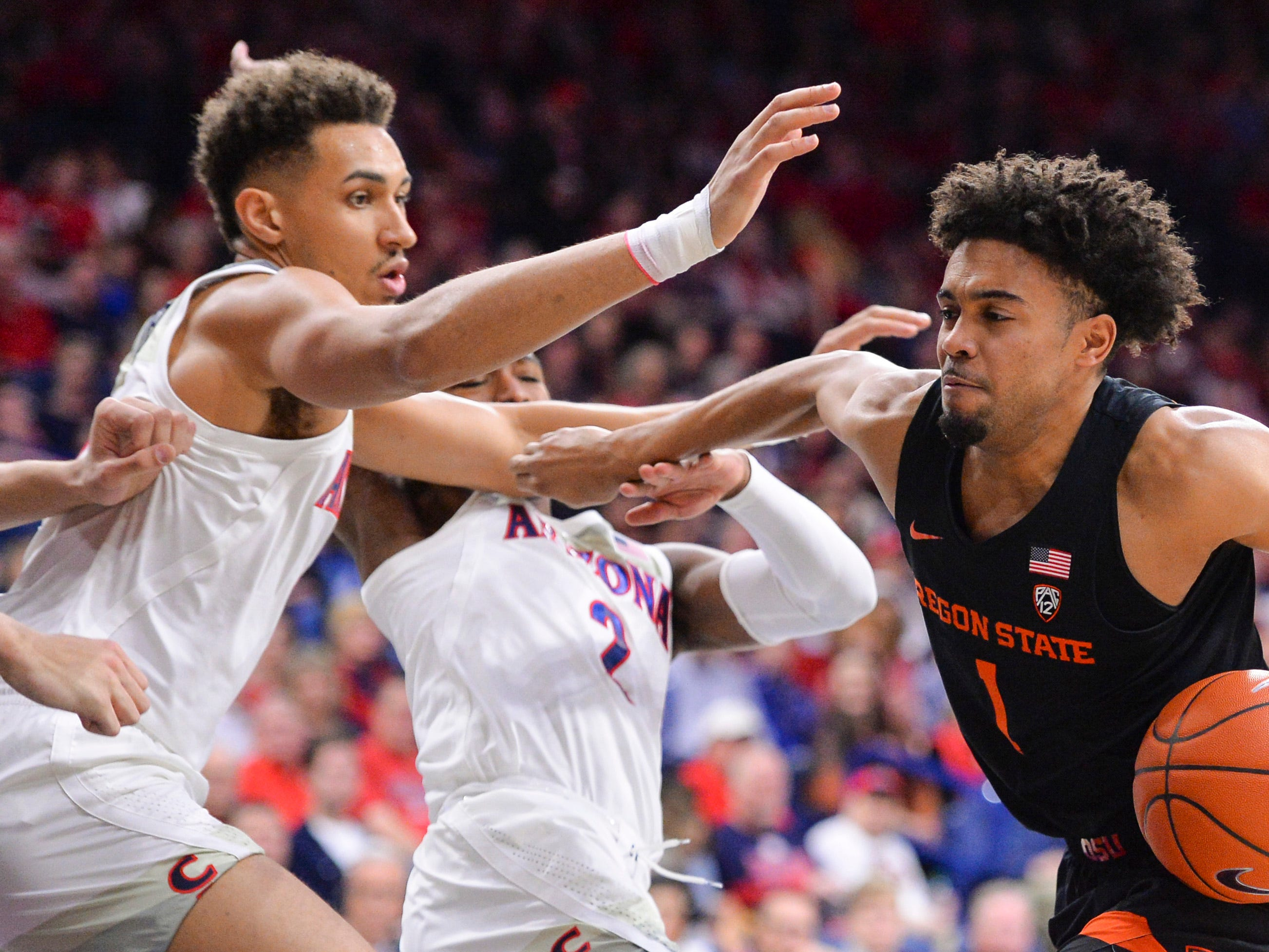 Jan 19, 2019; Tucson, AZ, USA; Oregon State Beavers guard Stephen Thompson Jr. (1) drives to the basket as Arizona Wildcats center Chase Jeter (4) defends during the first half at McKale Center. Mandatory Credit: Casey Sapio-USA TODAY Sports