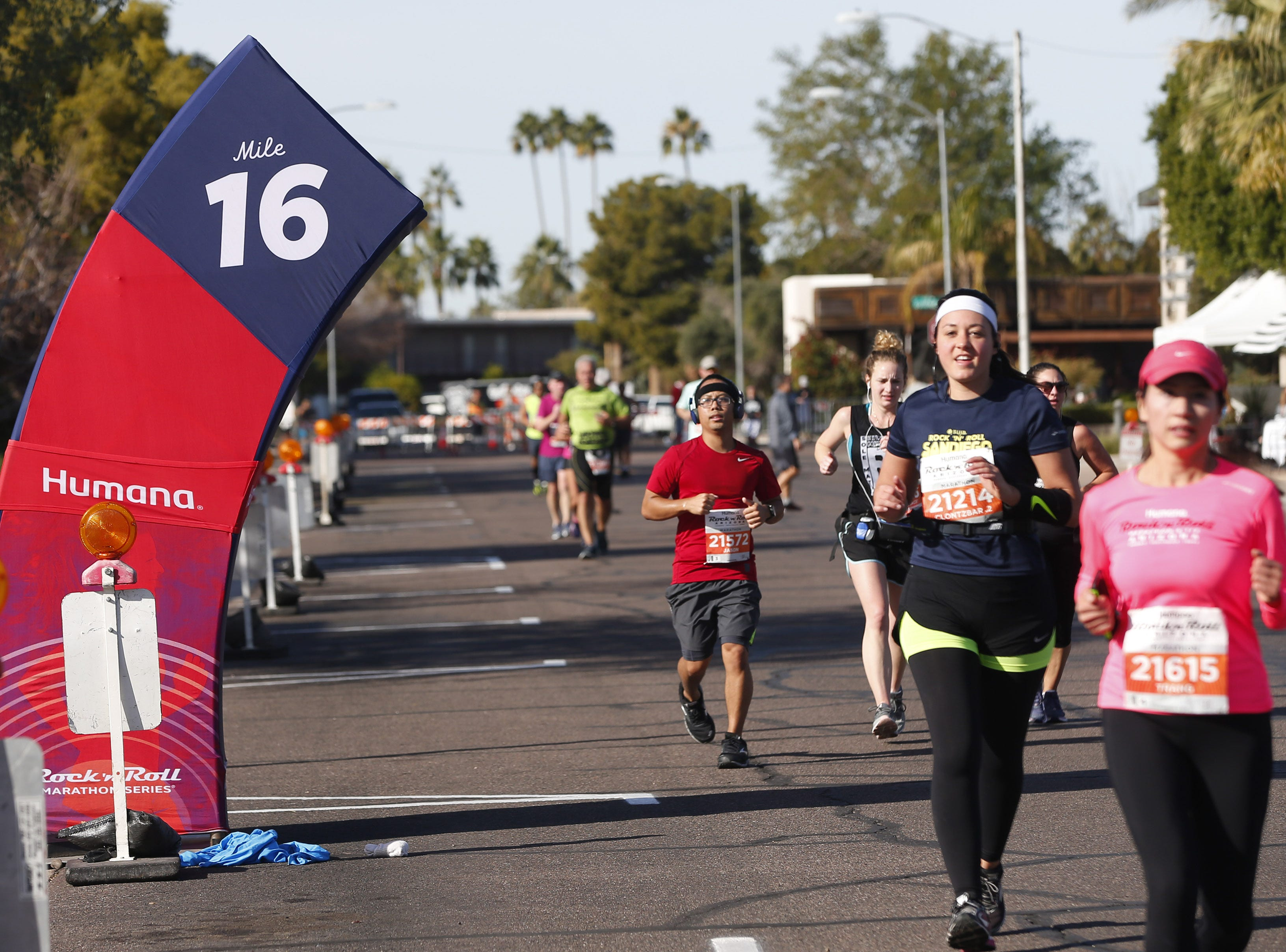 Runners cross the 16-mile marker during the Rock 'N' Roll Marathon in Scottsdale on Jan. 20, 2019.