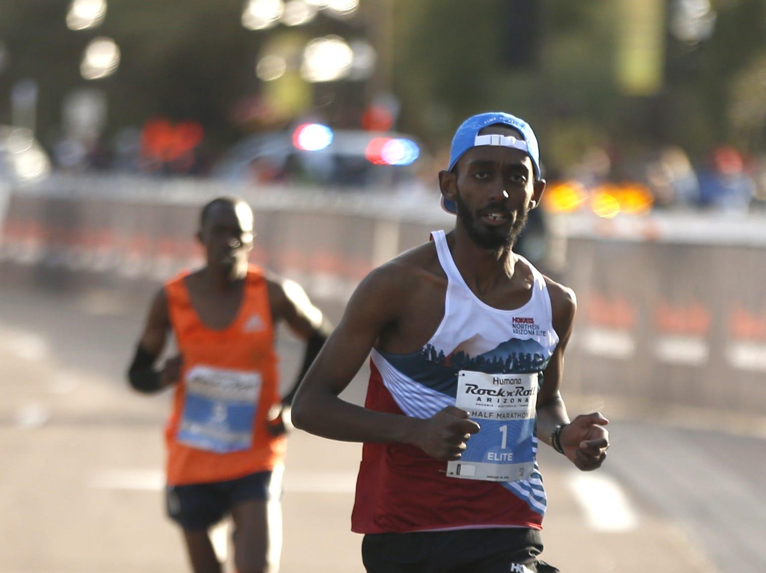 Kiya Dendena (1) comes in second place during the Rock 'N' Roll half-marathon in Tempe on Jan. 20, 2019.