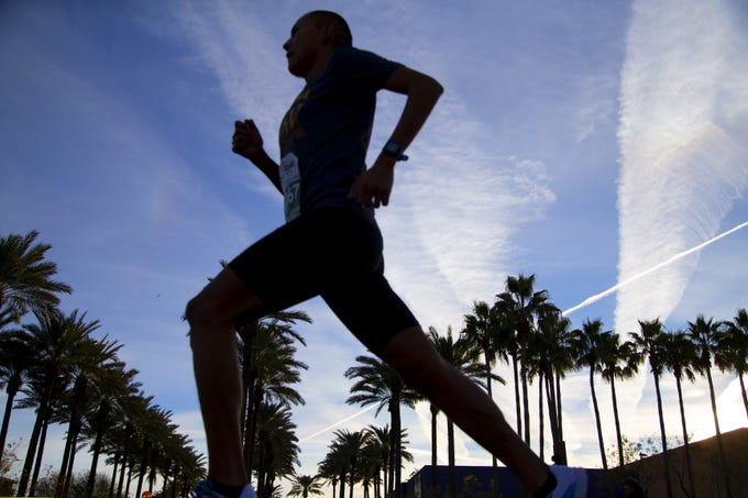 Runners compete in the Humana Rock 'N' Roll half-marathon near Tempe Market Place on Jan. 20, 2019.