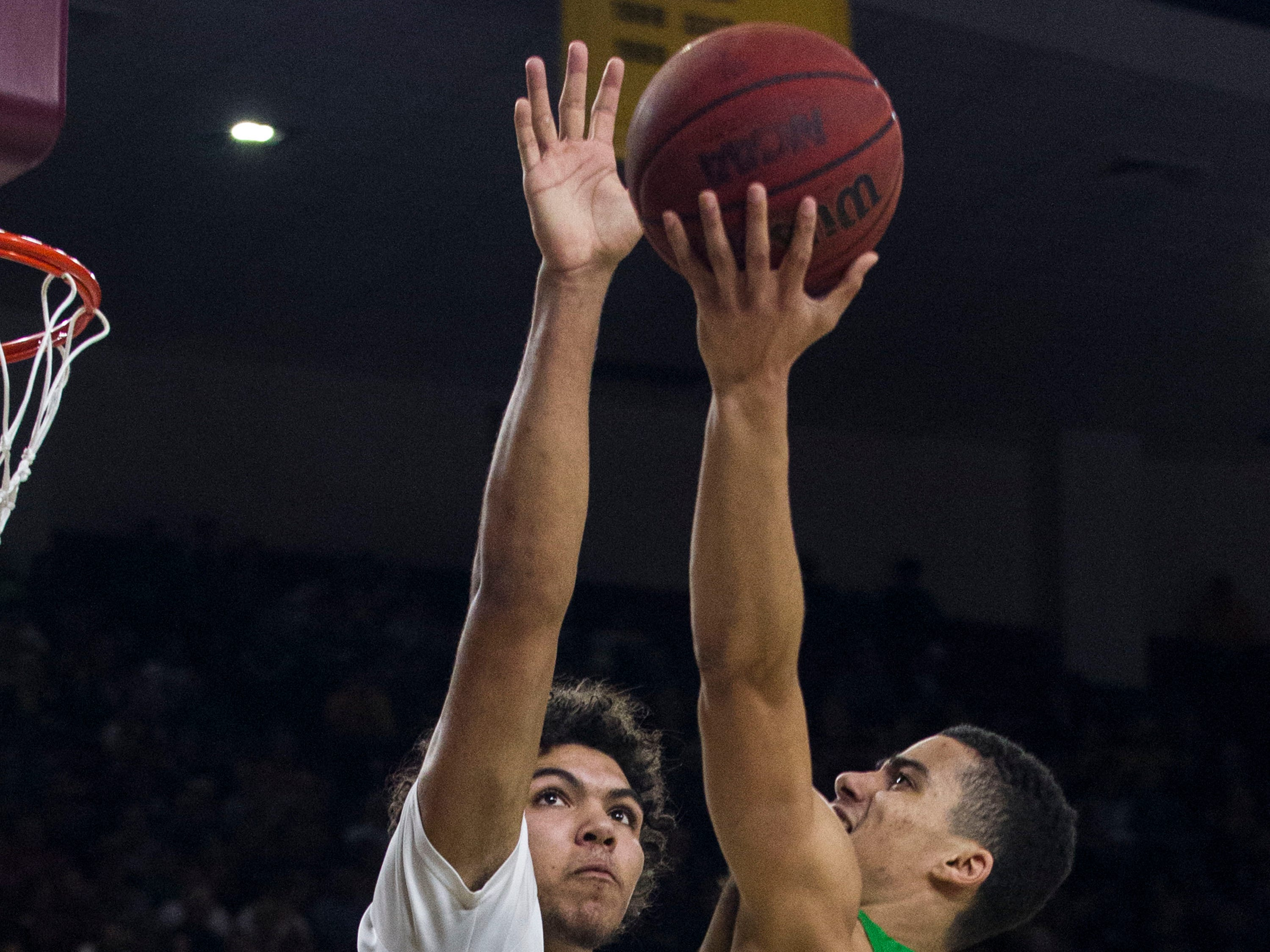 Arizona State's Taeshon Cherry (35) goes in for a block against Oregon's Will Richardson (0) during the first half, Saturday, Jan. 19, 2019, in Tempe, Ariz. (AP Photo/Darryl Webb)