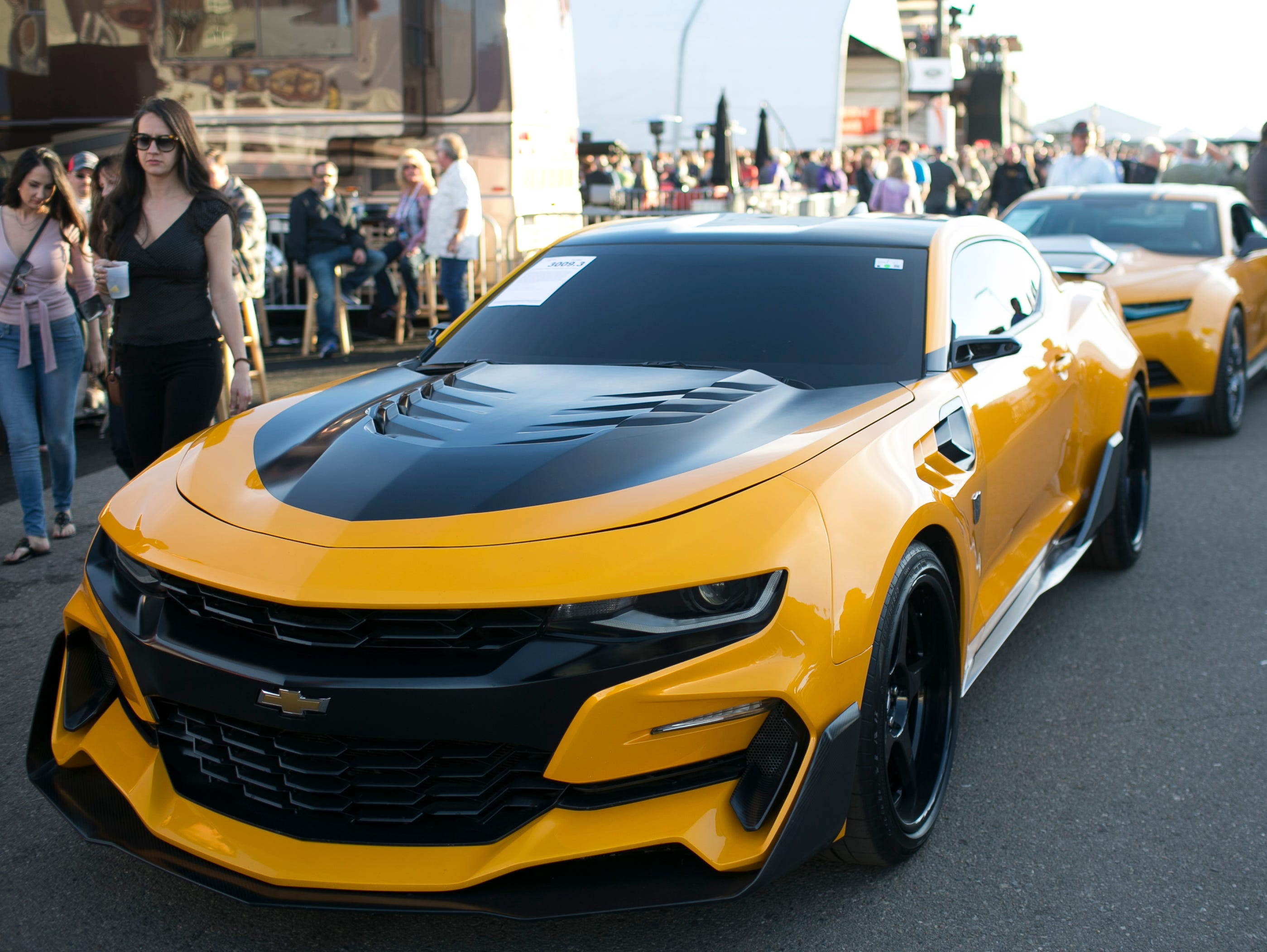 Two of four original Bumblebee Camaros from the Transformers film franchise sit outside the auction block at Barrett-Jackson collector-car auction at WestWorld on Jan. 19, 2019, in Scottsdale. The four sold for $500,000 total with the money going to benefit Operation Homefront, a non-profit that supports military families.