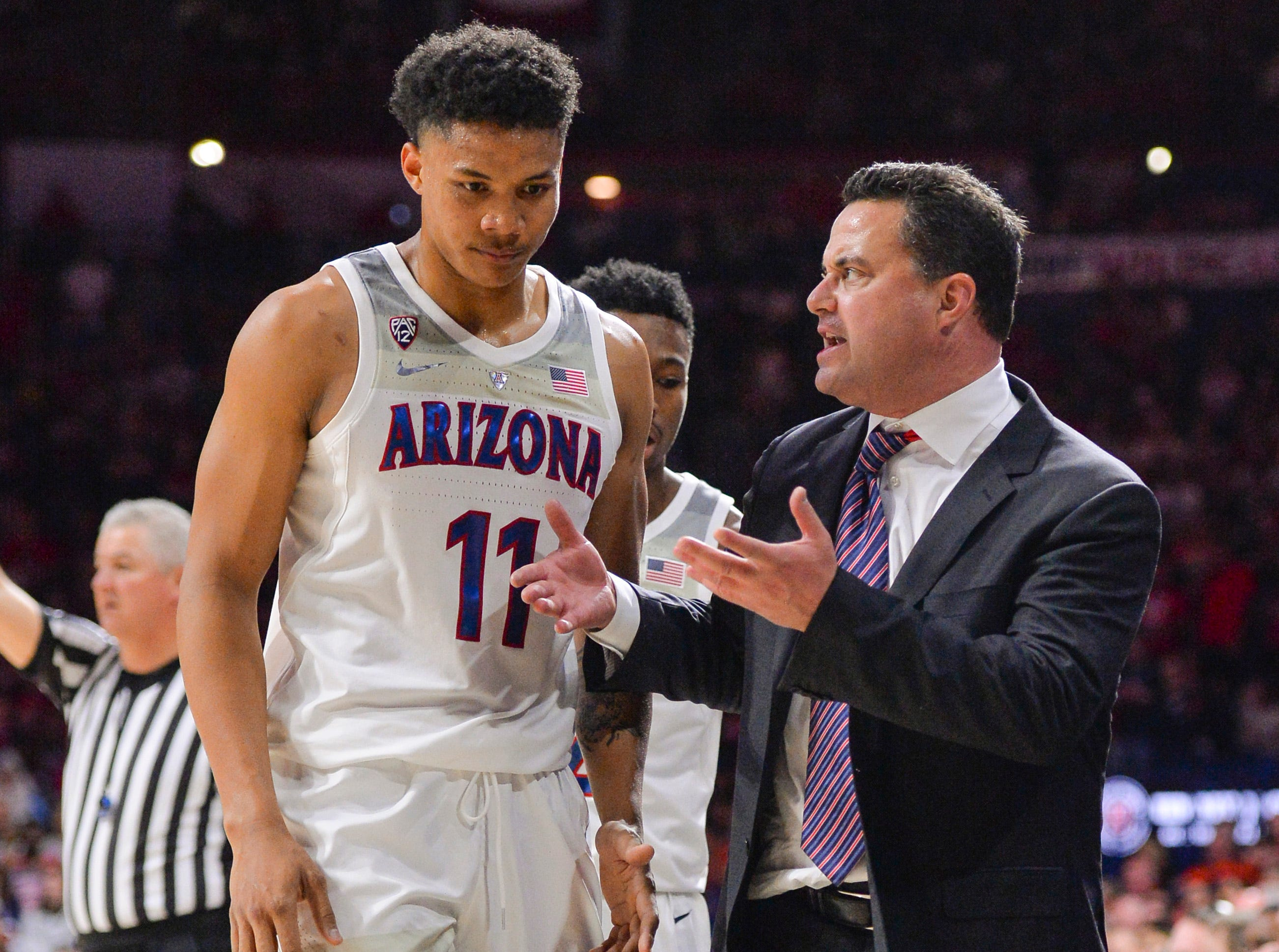 Jan 19, 2019; Tucson, AZ, USA; Arizona Wildcats head coach Sean Miller talks to forward Ira Lee (11) during the first half against the Oregon State Beavers at McKale Center. Mandatory Credit: Casey Sapio-USA TODAY Sports