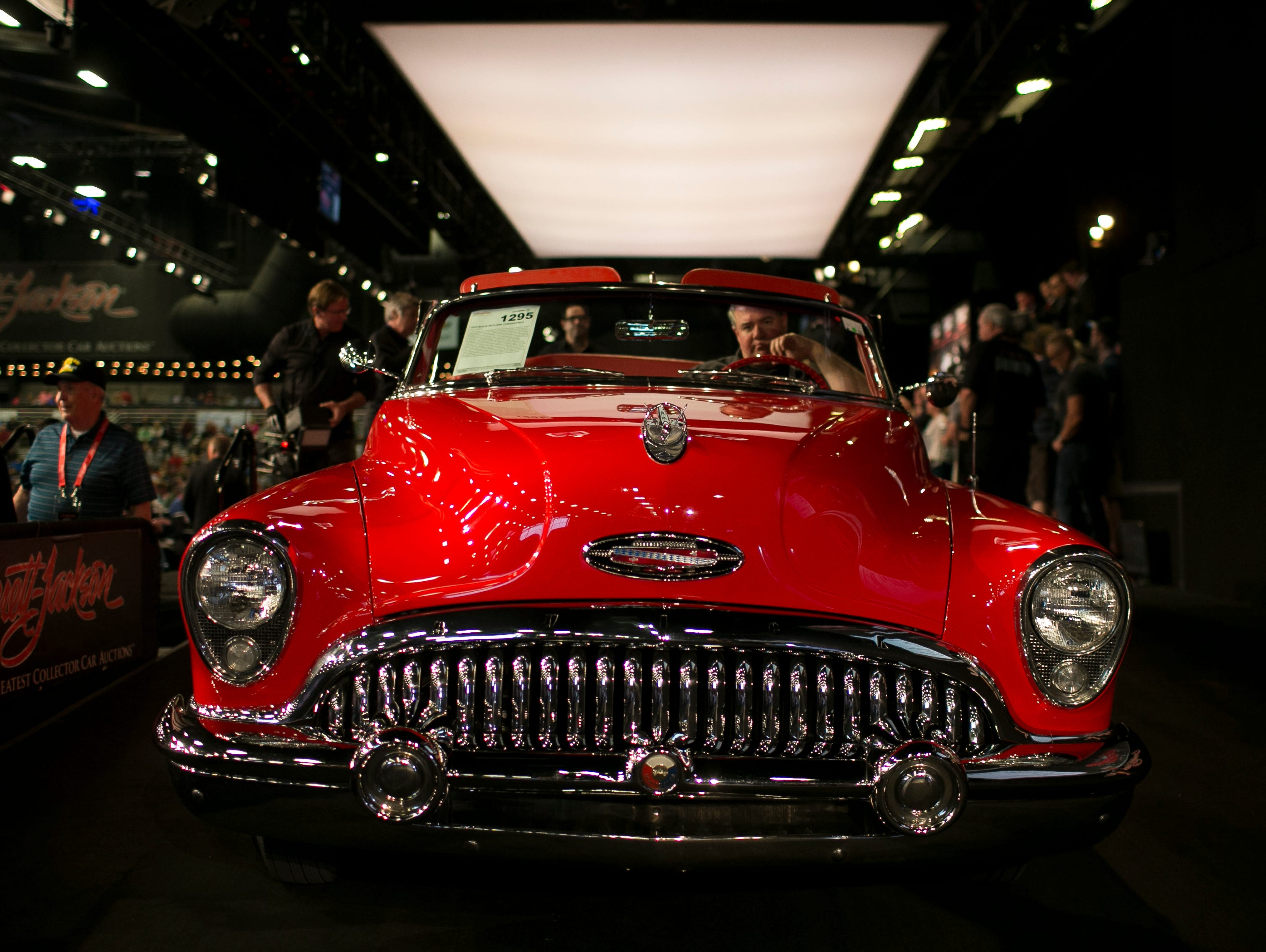 A 1953 Buick Skylark Convertible is driven on the auction block at Barrett-Jackson collector-car auction at WestWorld on Sat. January 19, 2019 in Scottsdale, Ariz.