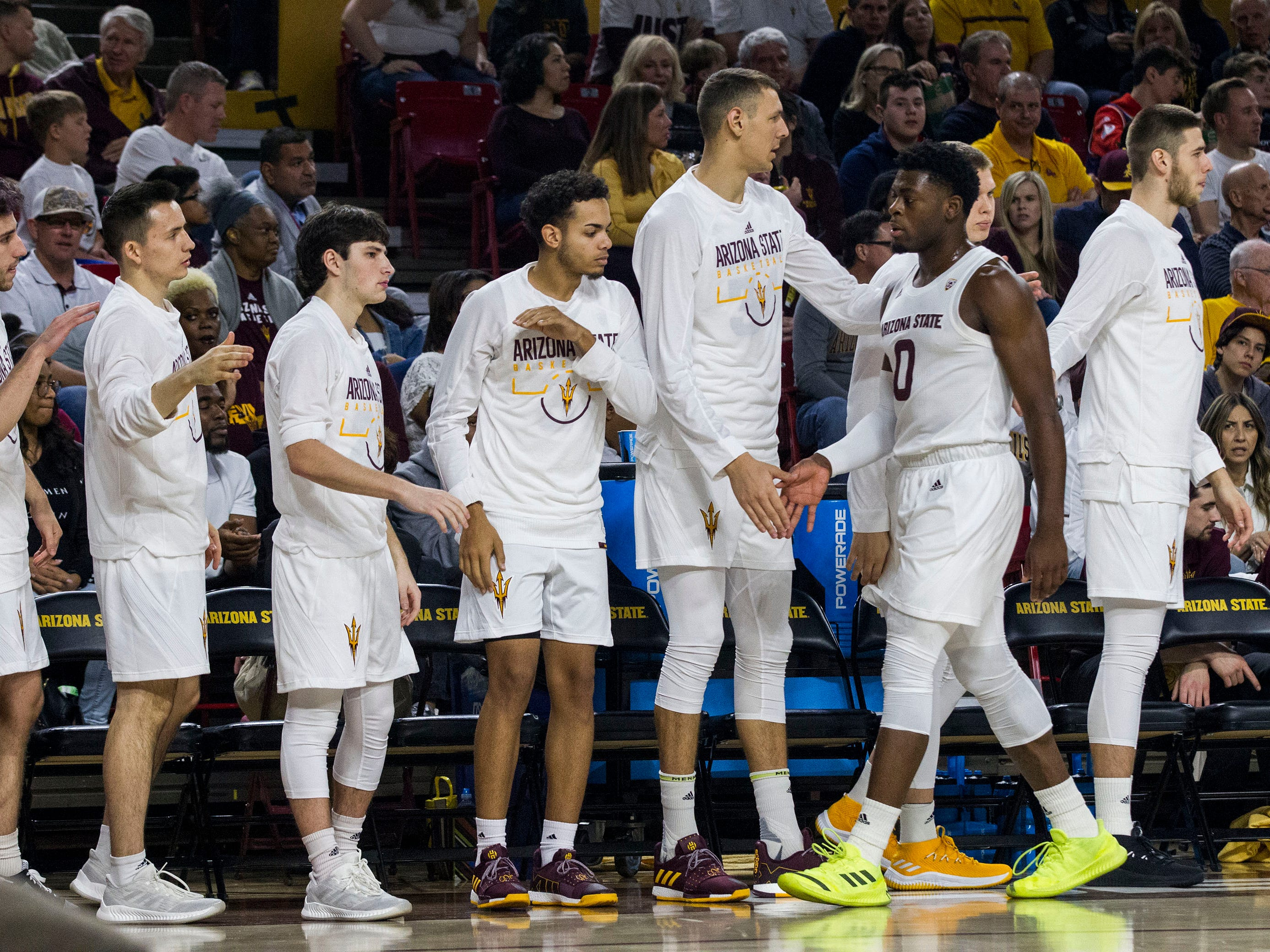Arizona State's Luguentz Dort (0) is greeted by players on the bench as he come out of the game during the first half against Oregon, Saturday, Jan. 19, 2019, in Tempe, Ariz. (AP Photo/Darryl Webb)