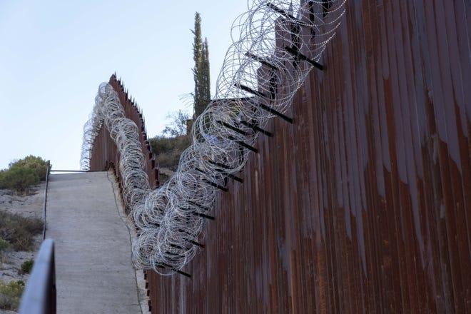 Border fence near the DeConcini crossing at the Arizona-Mexico border in Nogales, Arizona.