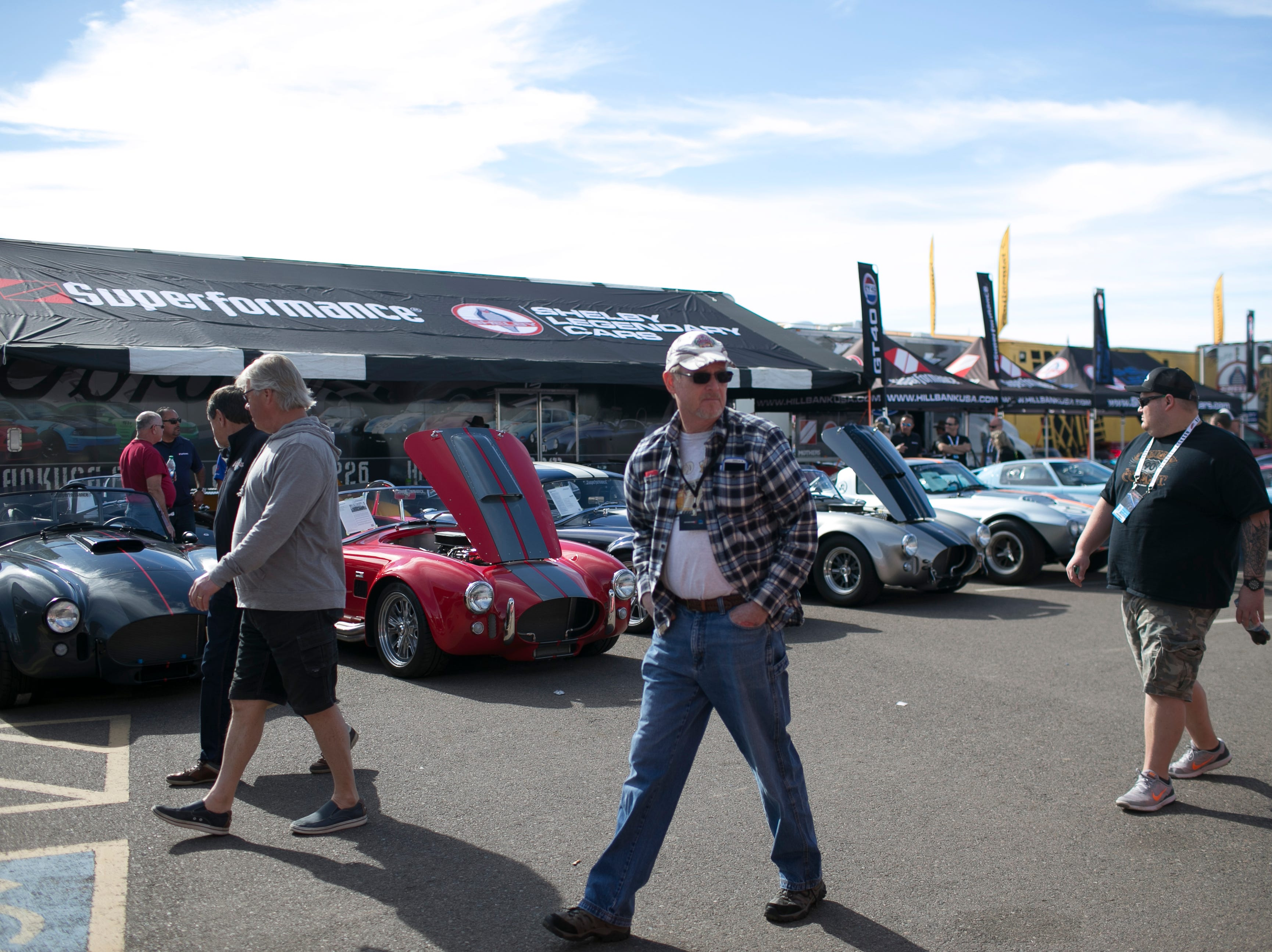 Visitors walk pasts rows of classic cars at Barrett-Jackson collector-car auction at WestWorld on Sat. January 19, 2019 in Scottsdale, Ariz.