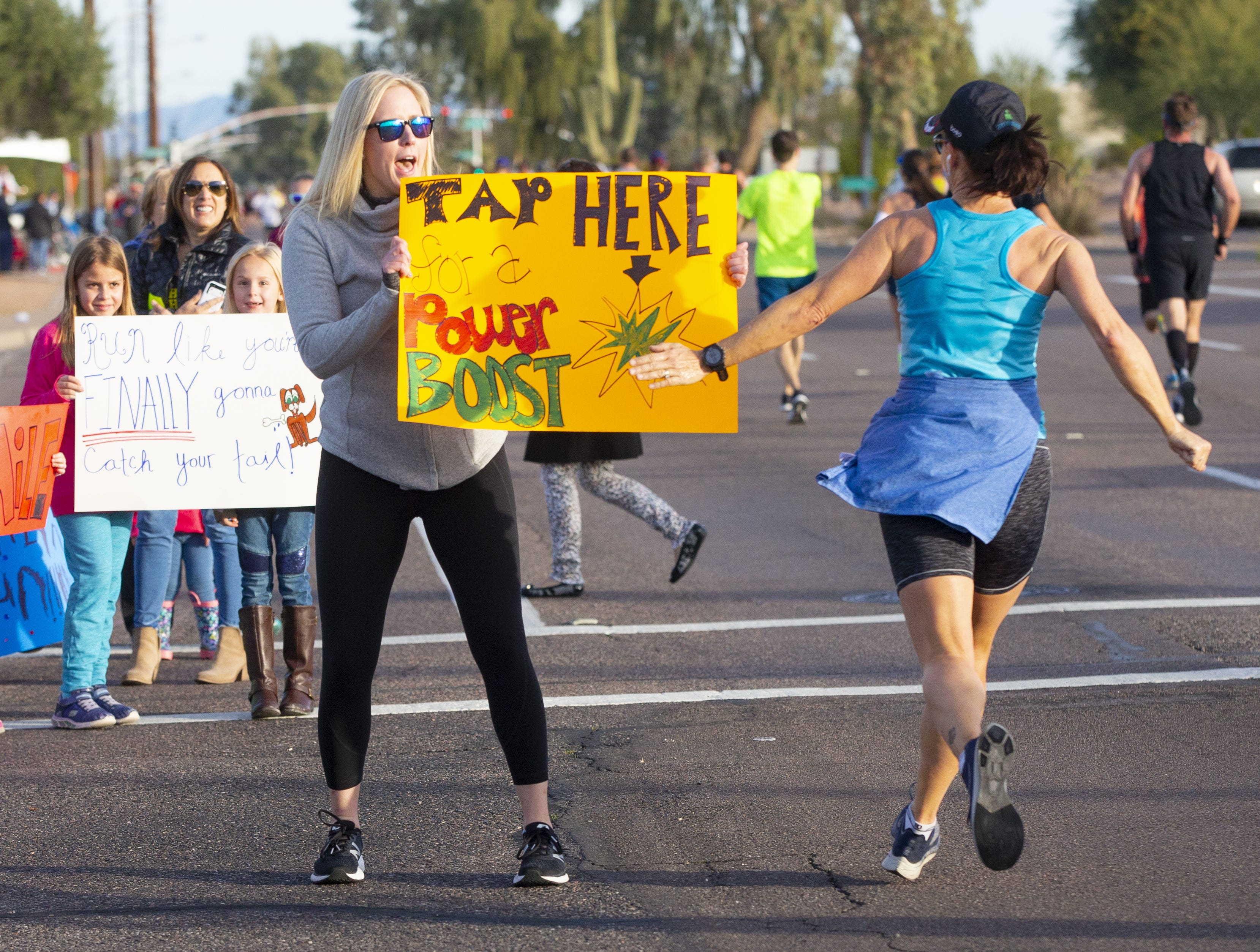Shelby Mobley of Chandler offers the runners a boost during the Humana Rock 'N' Roll half-marathon on Jan. 20, 2019.