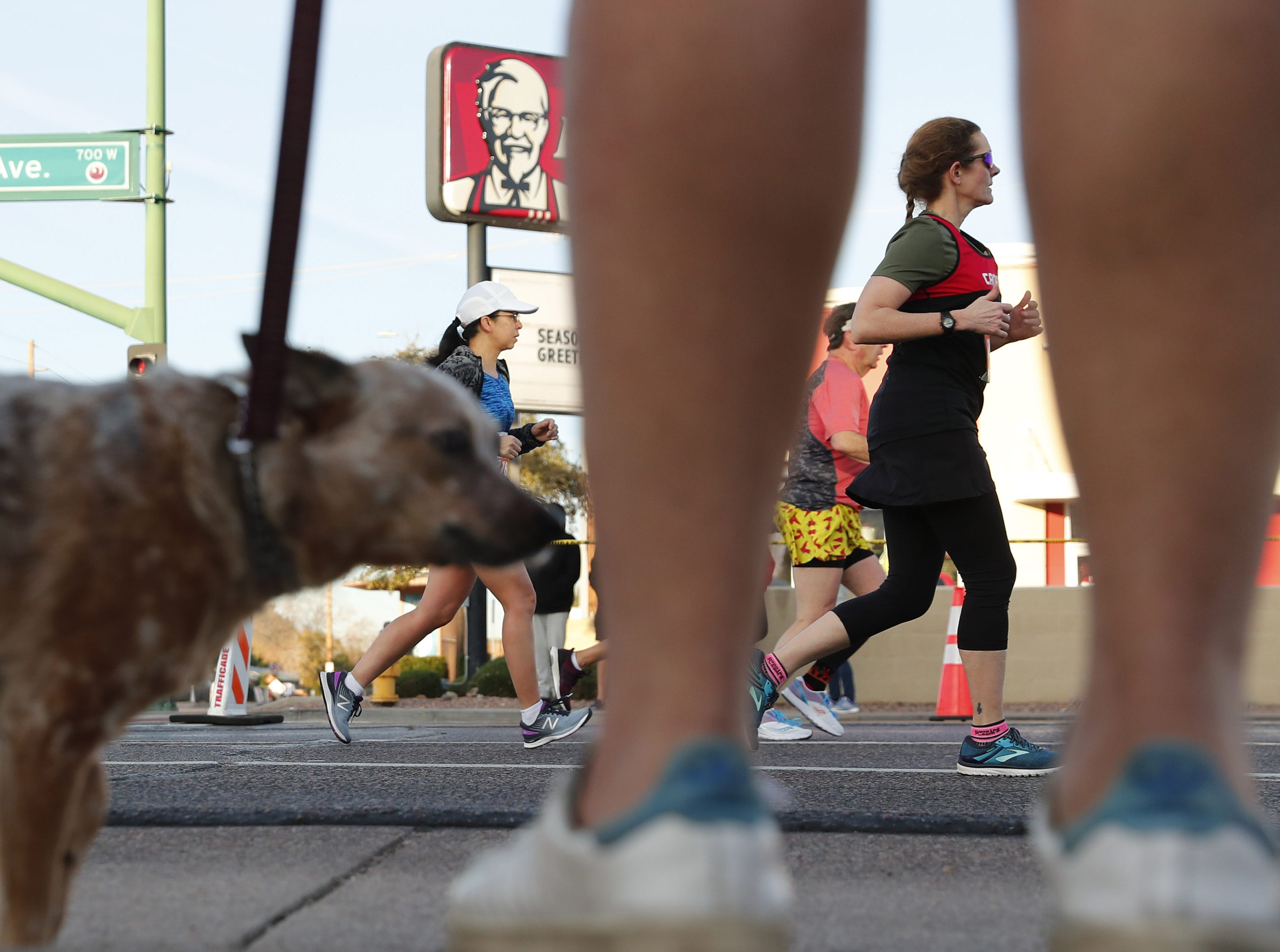 Runners make their way up 7th Ave. during the Rock 'N' Roll Marathon in Phoenix on Jan. 20, 2019.