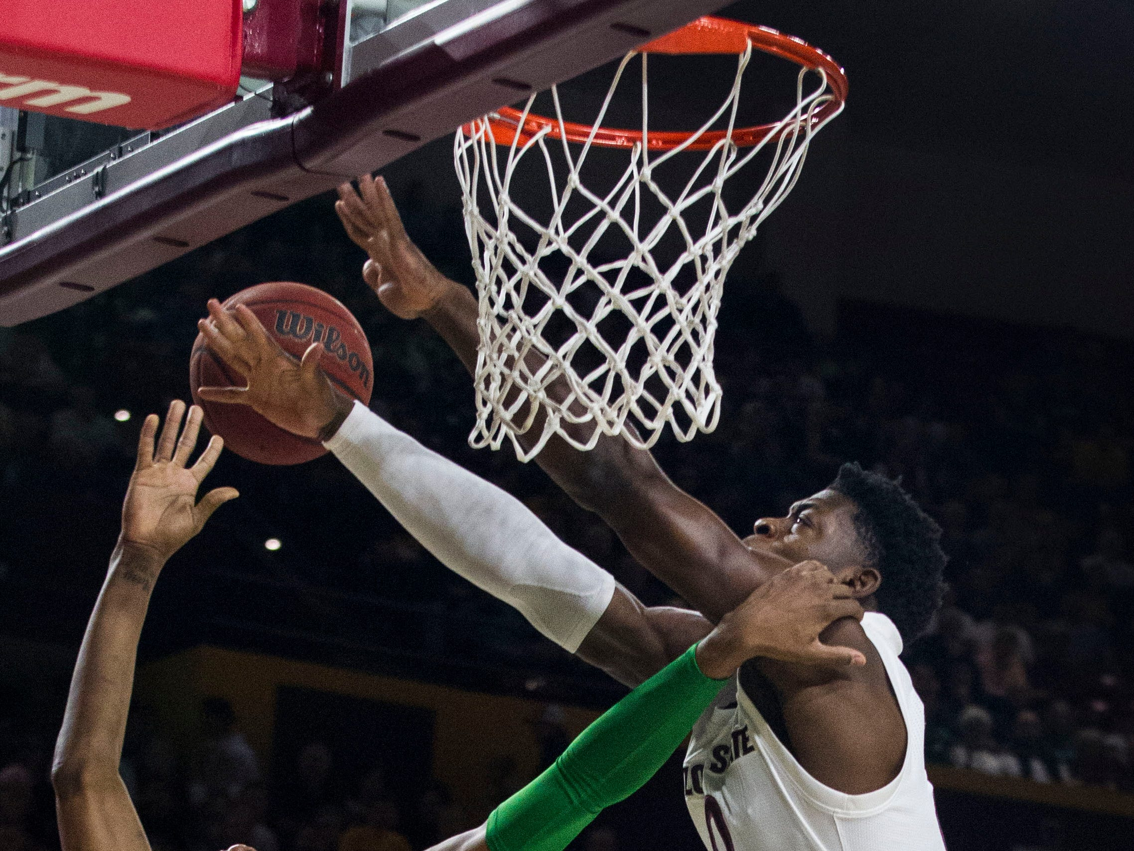 Arizona State's Luguentz Dort (0) fouls Oregon's Louis King (2) during the first half, Saturday, Jan. 19, 2019, in Tempe, Ariz. (AP Photo/Darryl Webb)