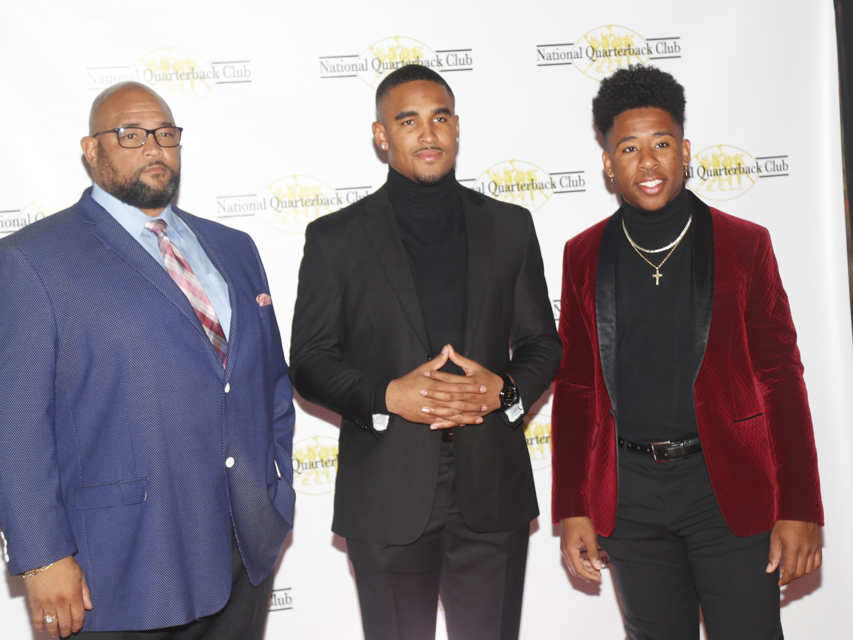 Oklahoma quarterback Jalen Hurts (center) with his father Averion Hurts (L) and his brother Averion Hurts Jr. (R) before the National Quarterback Club Awards Dinner & Hall of Fame Induction Ceremony The Scottsdale Resort at McCormick Ranch in Scottsdale, Ariz. on January 19, 2019.