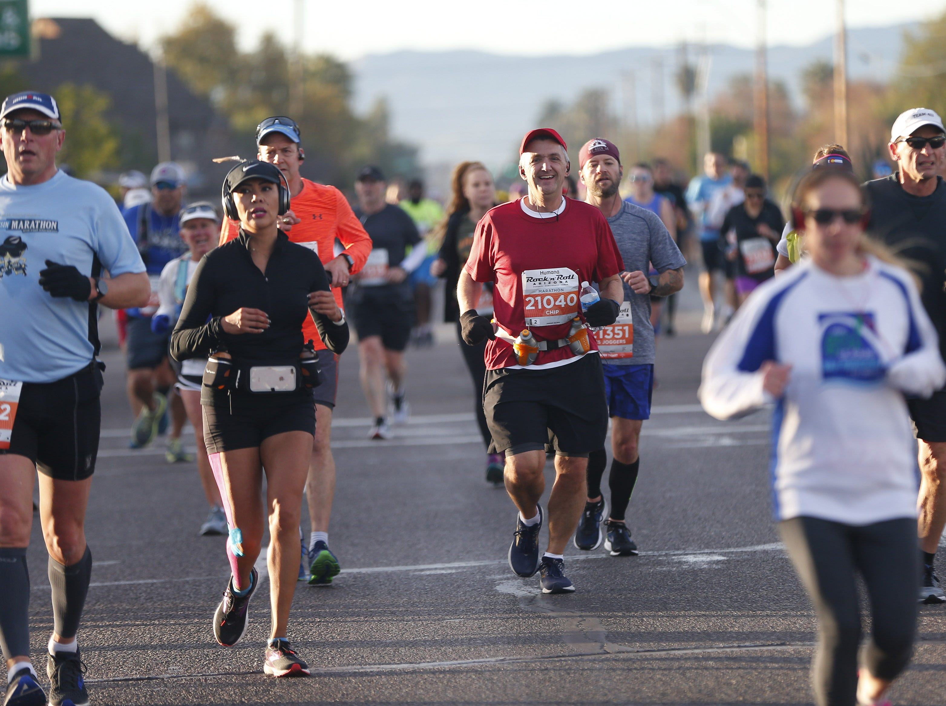 Runners make their way up 7th Ave. during the Rock 'n' Roll Marathon in Phoenix, Jan. 20, 2019.