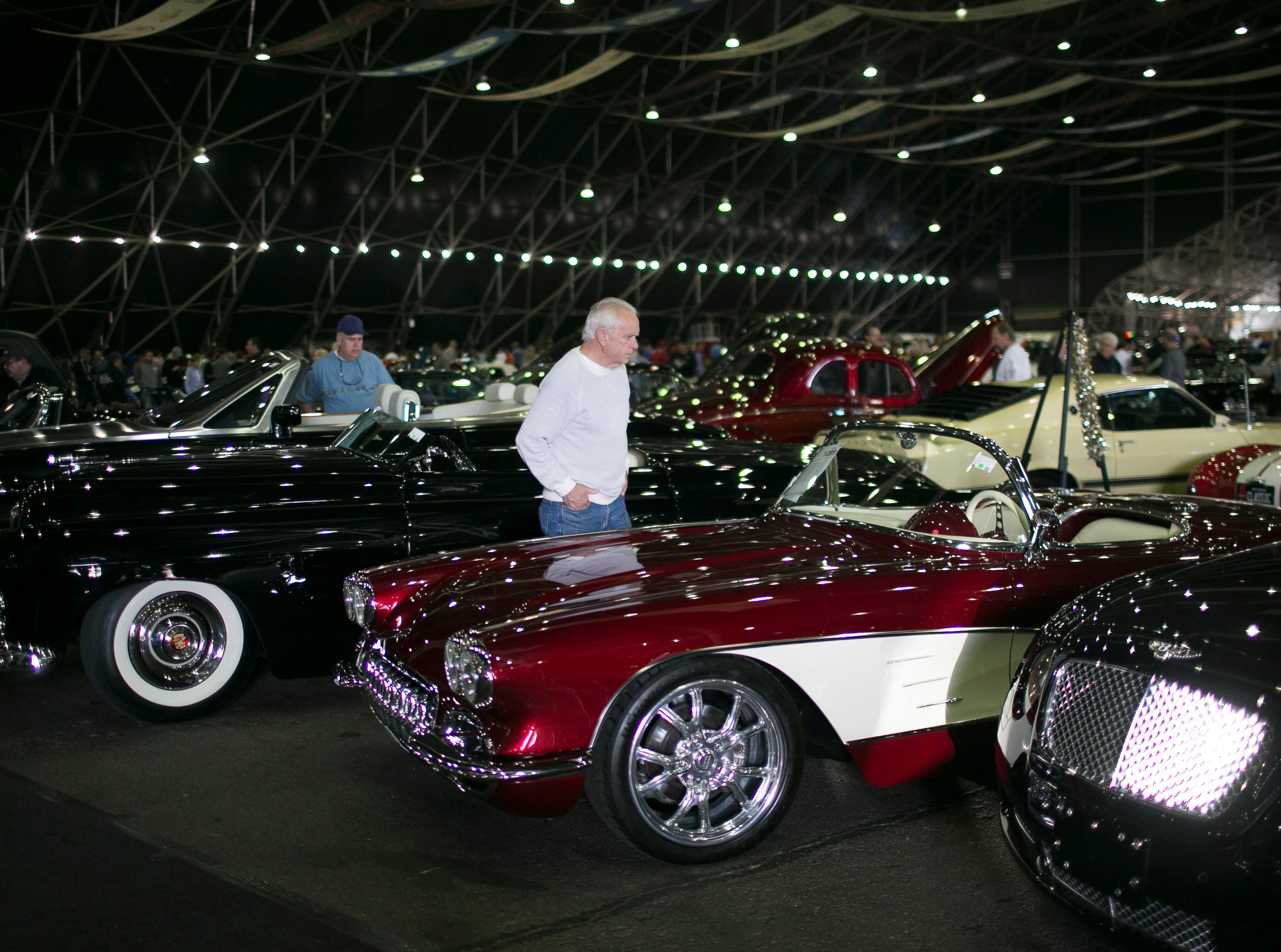 Visitors look at collector cars at Barrett-Jackson collector-car auction at WestWorld on Sat. January 19, 2019 in Scottsdale, Ariz.
