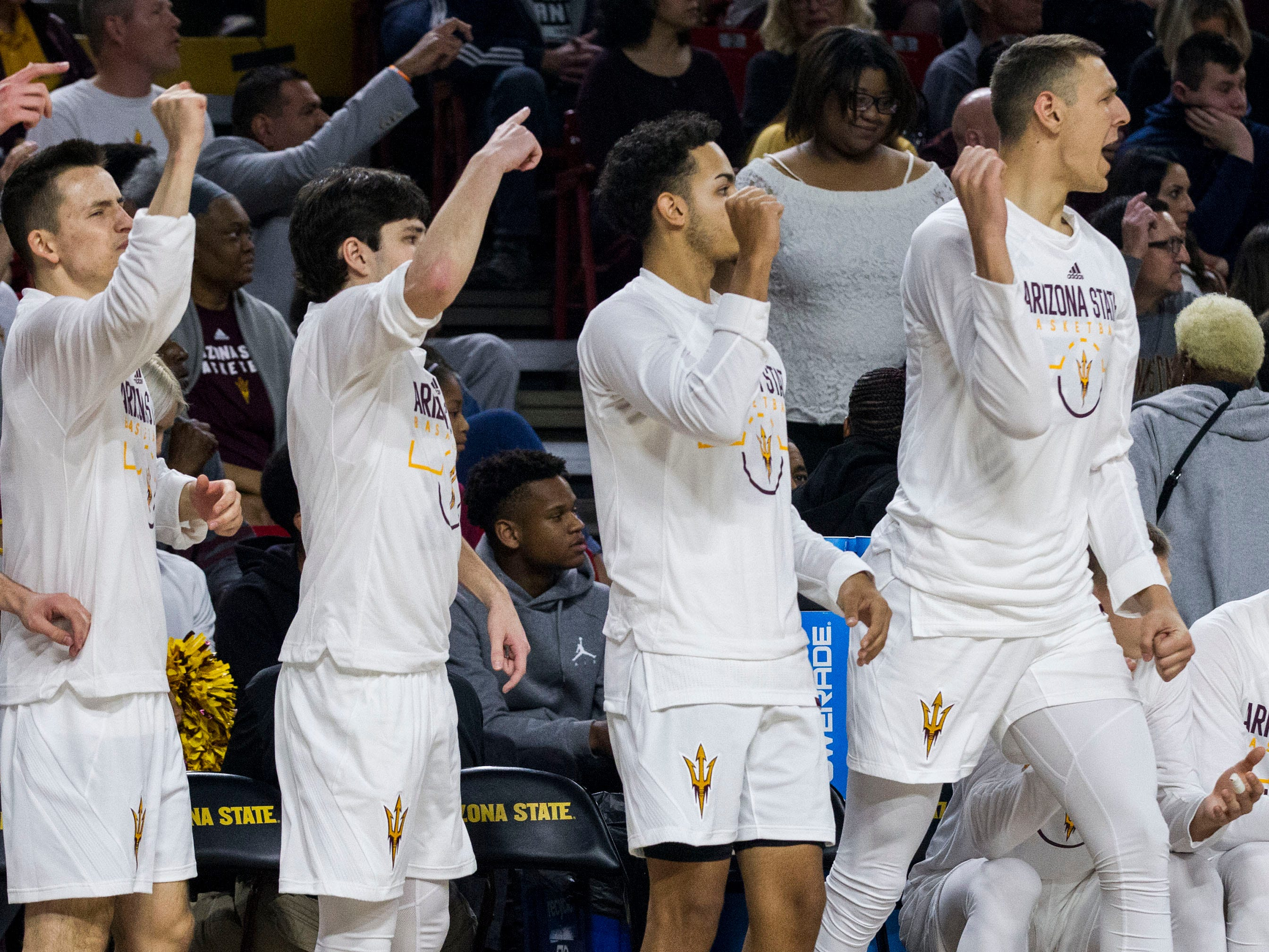 Arizona State players on the bench cheer on their team during the first half against Oregon, Saturday, Jan. 19, 2019, in Tempe, Ariz. (AP Photo/Darryl Webb)