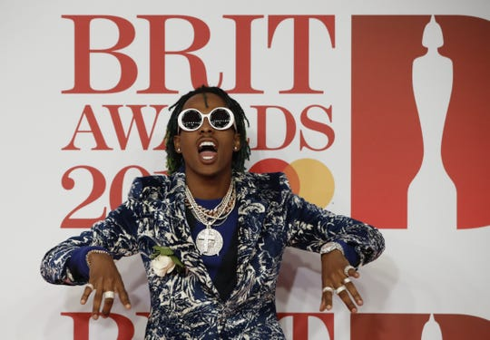 US rapper Dimitri Leslie Roger, better known as 'Rich the Kid', poses on the red carpet on arrival for the BRIT Awards 2018 in London.