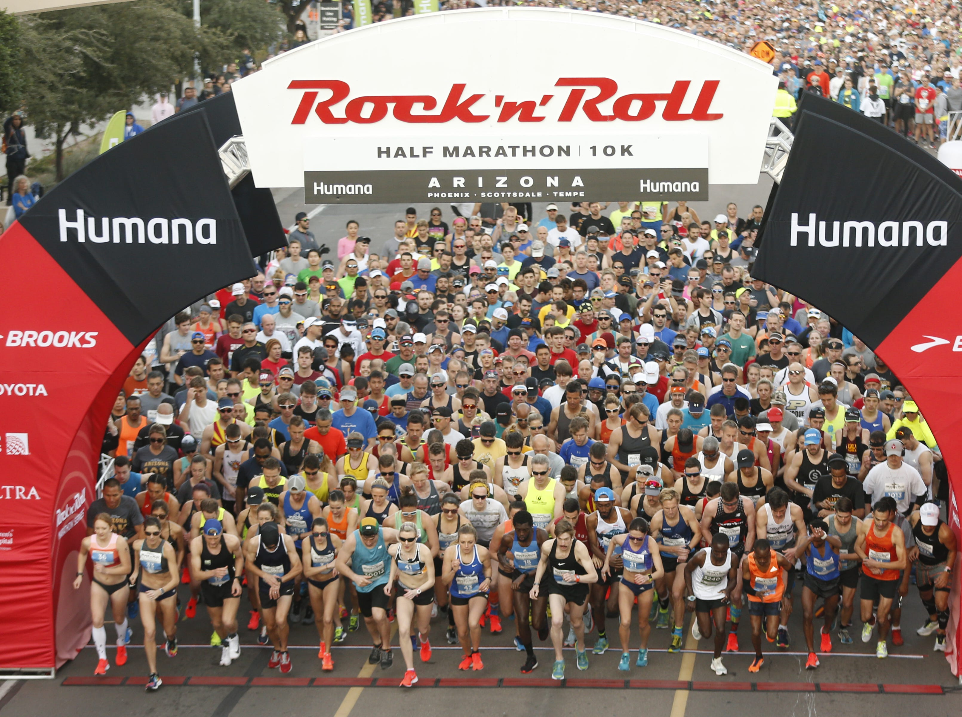 The elite runners take off from the start line during the Rock 'N' Roll half-marathon in Tempe on Jan. 20, 2019.