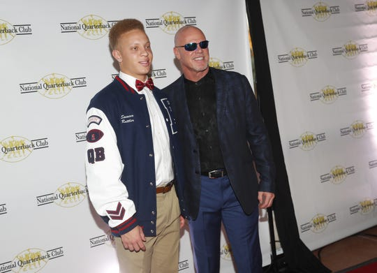 Former NFL quarterback Jim McMahon and Pinnacle high school quarterback Spencer Rattler poses for pictures before the National Quarterback Club Awards Dinner & Hall of Fame Induction Ceremony The Scottsdale Resort at McCormick Ranch in Scottsdale, Ariz. on January 19, 2019.