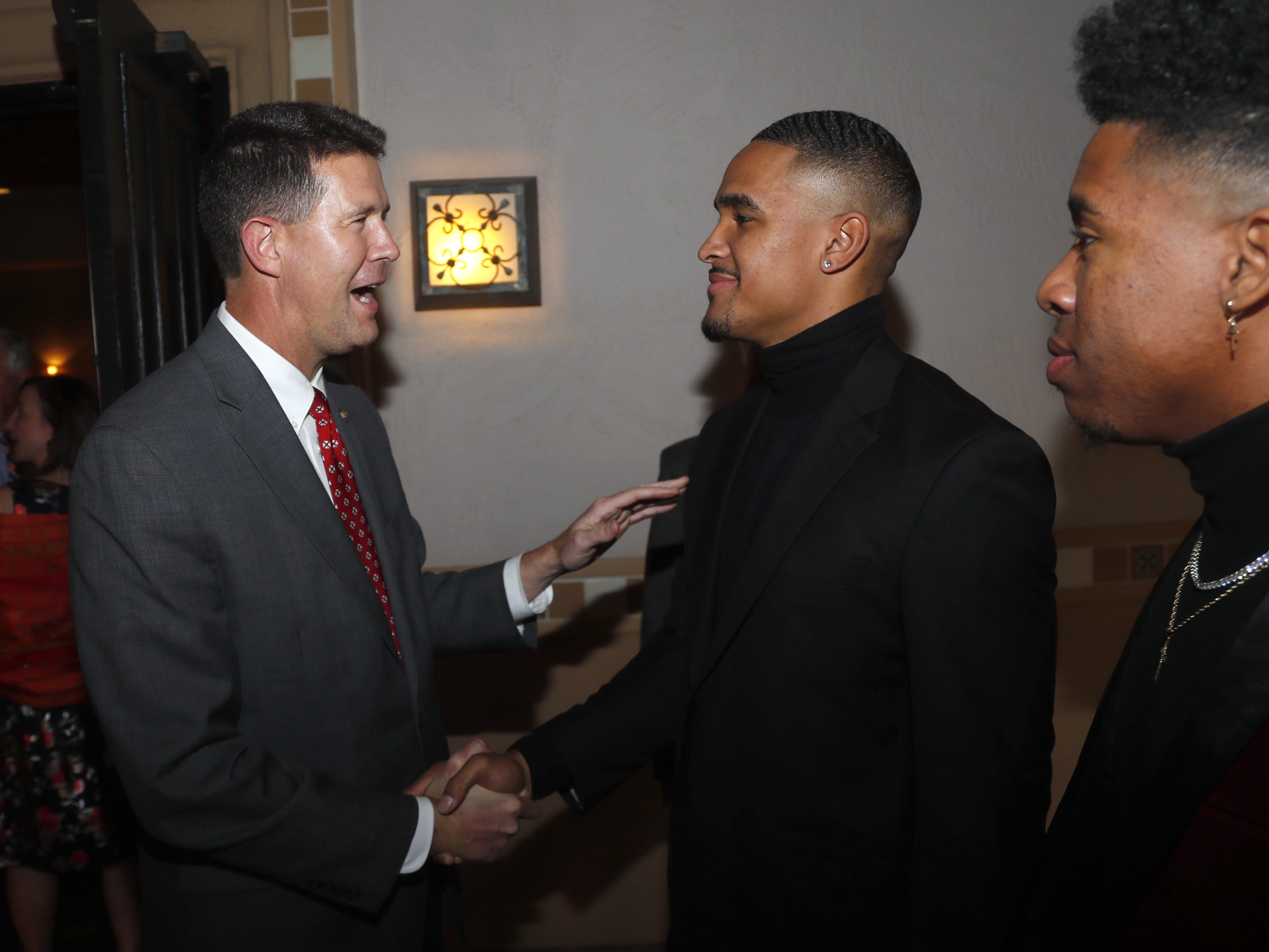 Alabama secretary of State John Merrill (L) shakes hands and speaks with former Alabama quarterback Jalen Hurts before the National Quarterback Club Awards Dinner & Hall of Fame Induction Ceremony The Scottsdale Resort at McCormick Ranch in Scottsdale, Ariz. on January 19, 2019.