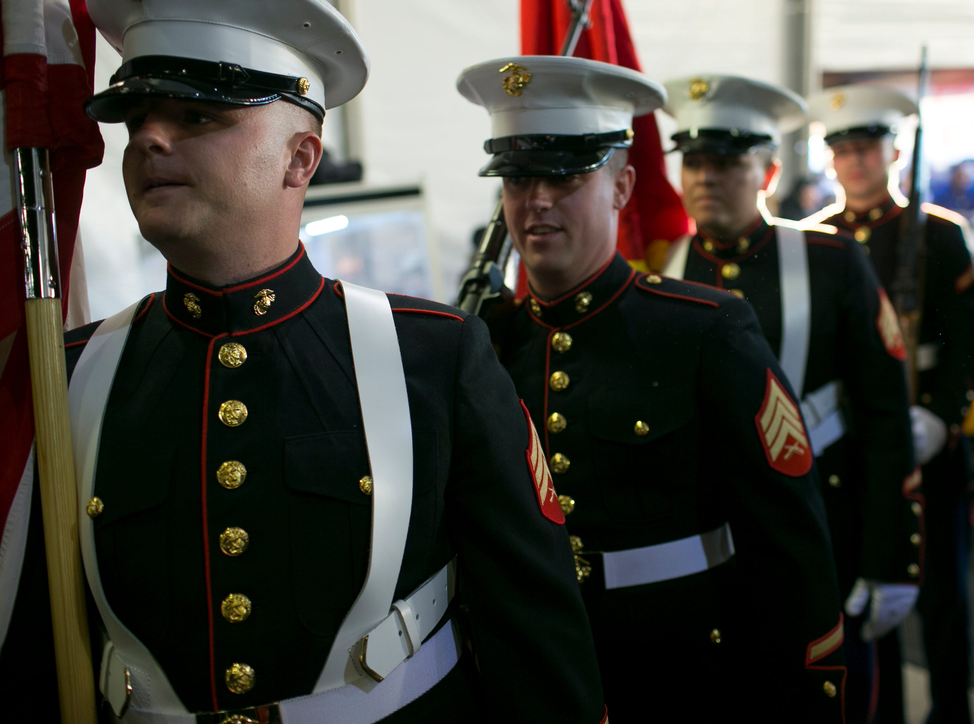 Sgt. Hill (front, left) Sgt. Fritz (right), Sgt. Martinez (second-right) and Private First Class McKinley (far right, last) of the Marine Corps Bulk Fuel Company ÒCÓ, 6th ESB, 4th MLG Color Guard prepares to lead Four original Bumblebee Camaros from the Transformers film franchise to be auctioned off for the non-profit Operation Homefront at Barrett-Jackson collector-car auction at WestWorld on Sat. January 19, 2019 in Scottsdale, Ariz.