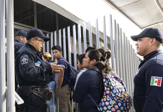 Migrants arrive on Jan. 19, 2019, at Mexican immigration services in Nogales, Sonora, Mexico, after being deported from the United States.