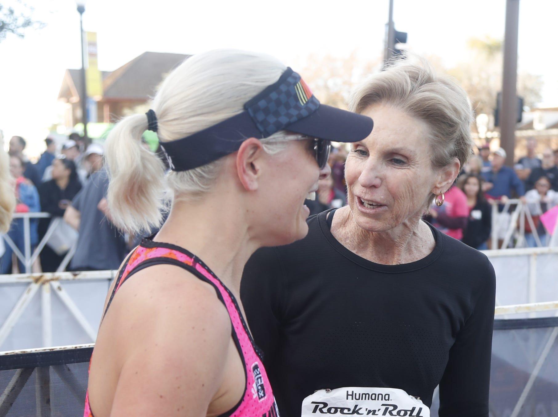 Paula Newby-Fraser (R) greets Sen. Kyrsten Sinema after Sinema finished the Rock 'n' Roll half-marathon in Tempe on Jan. 20, 2019.