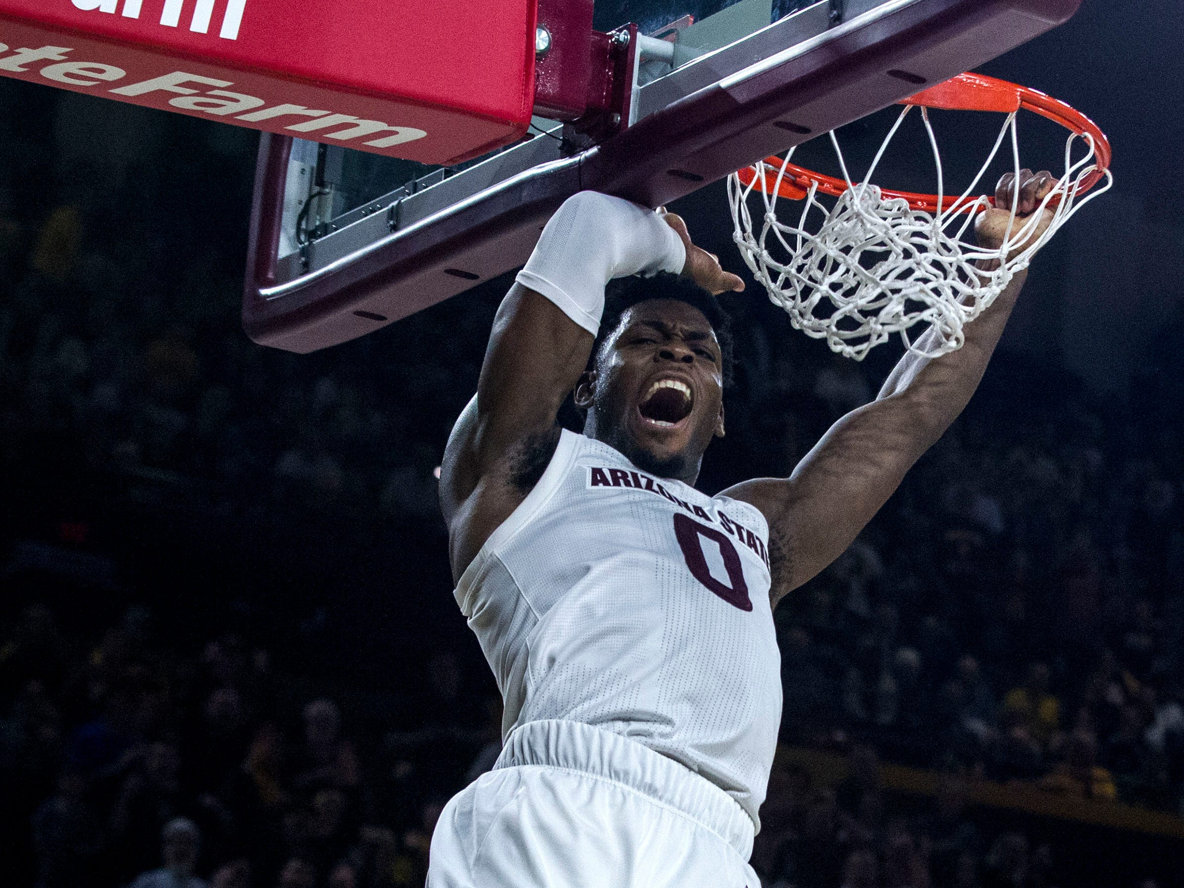 Arizona State's Luguentz Dort (0) dunks against Oregon during the second half, Saturday, Jan. 19, 2019, in Tempe, Ariz. Arizona State won 78-64. (AP Photo/Darryl Webb)