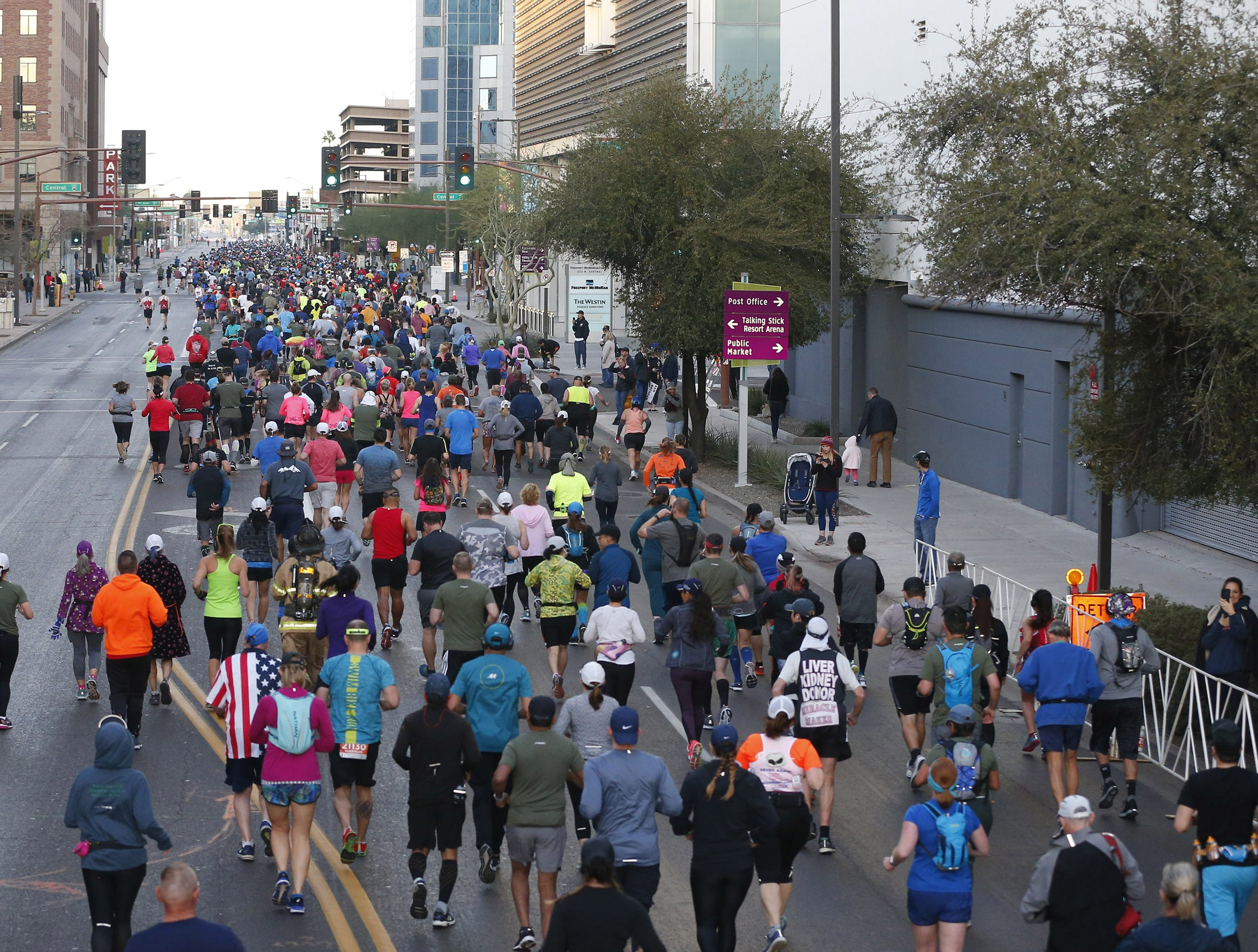 Runners make their way down Van Buren St. during the Rock 'n' Roll Marathon in Phoenix, Jan. 20, 2019.