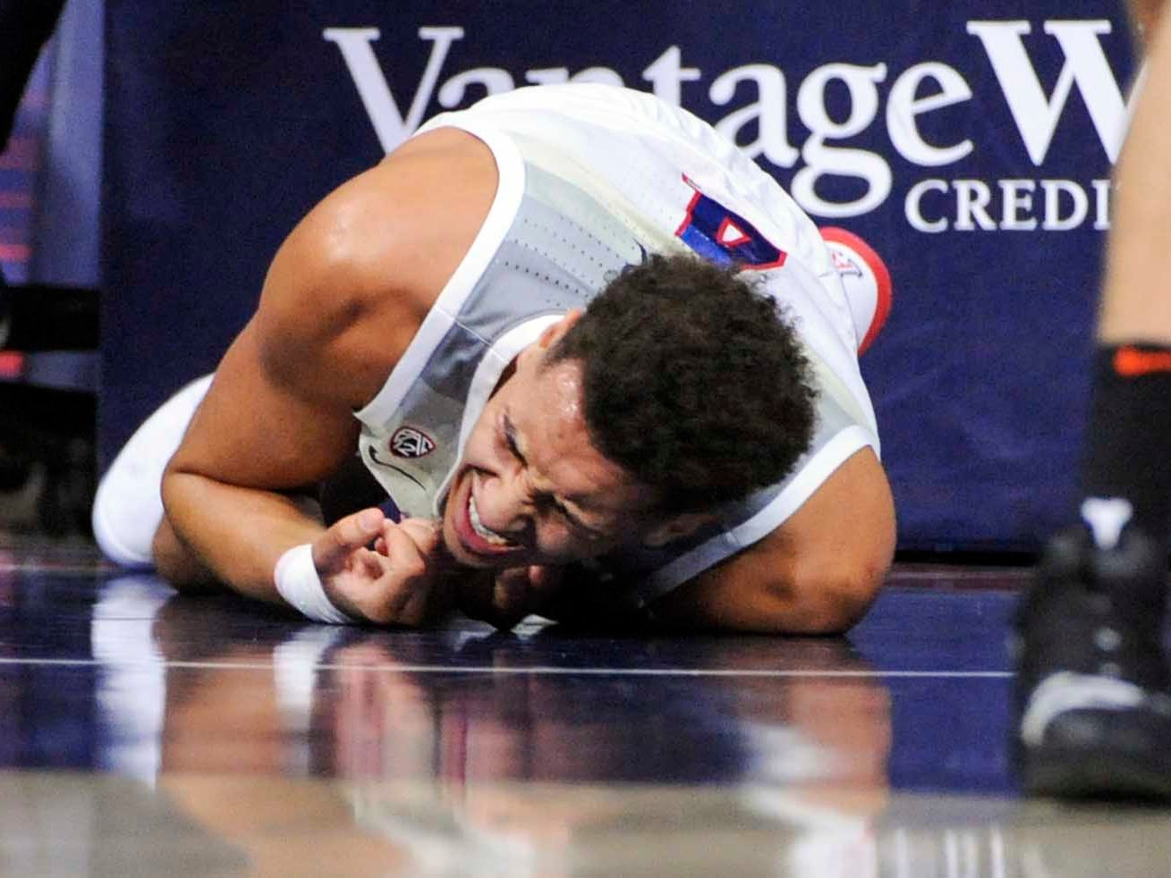 Jan 19, 2019; Tucson, AZ, USA; Arizona Wildcats center Chase Jeter (4) writhes in pain after going down hard during the first half against the Oregon State Beavers at McKale Center. Mandatory Credit: Casey Sapio-USA TODAY Sports