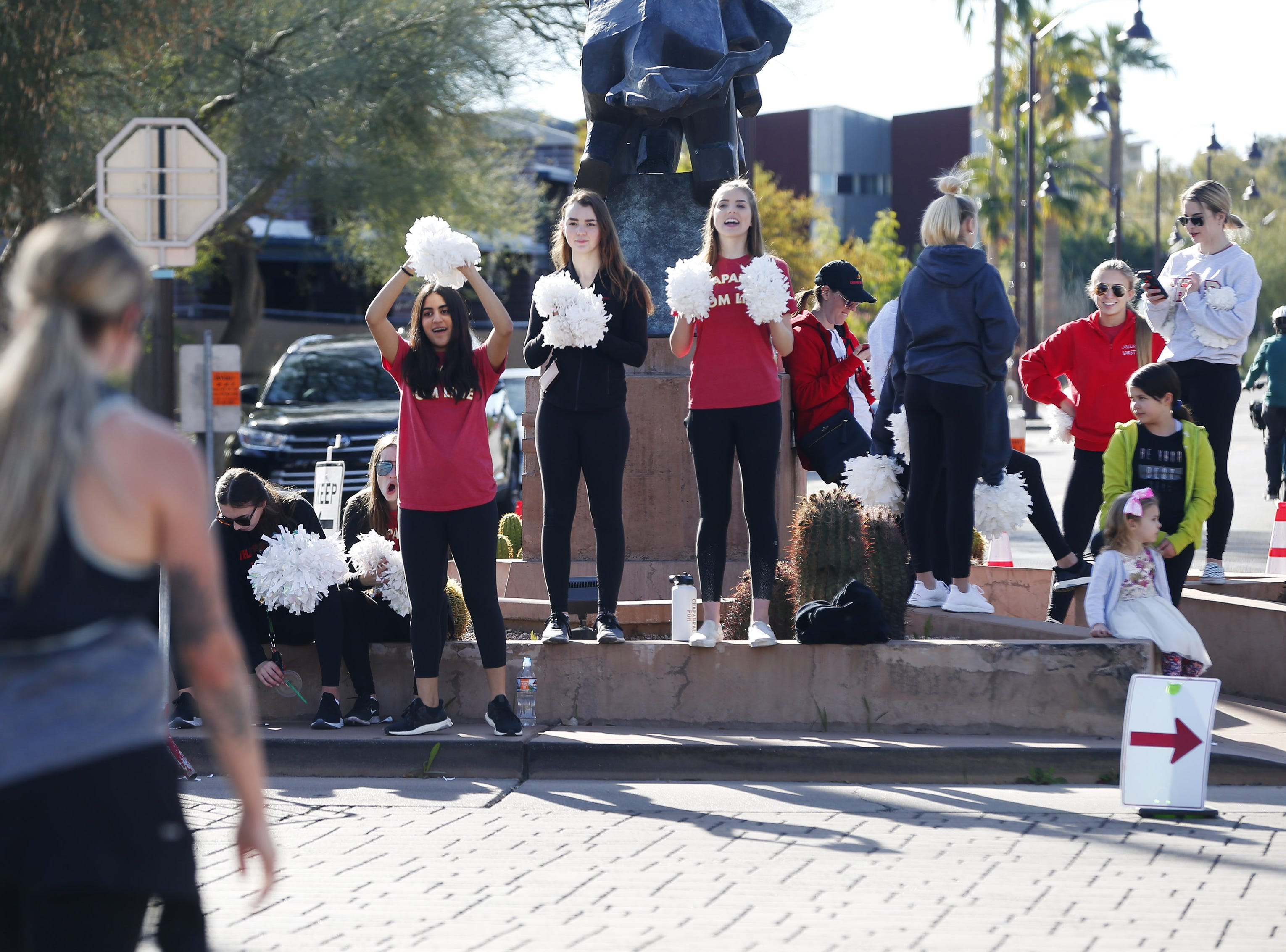 Chaparral High students cheer for runners on N. Marshall Way during the Rock 'n' Roll Marathon in Scottsdale Jan. 20, 2019.