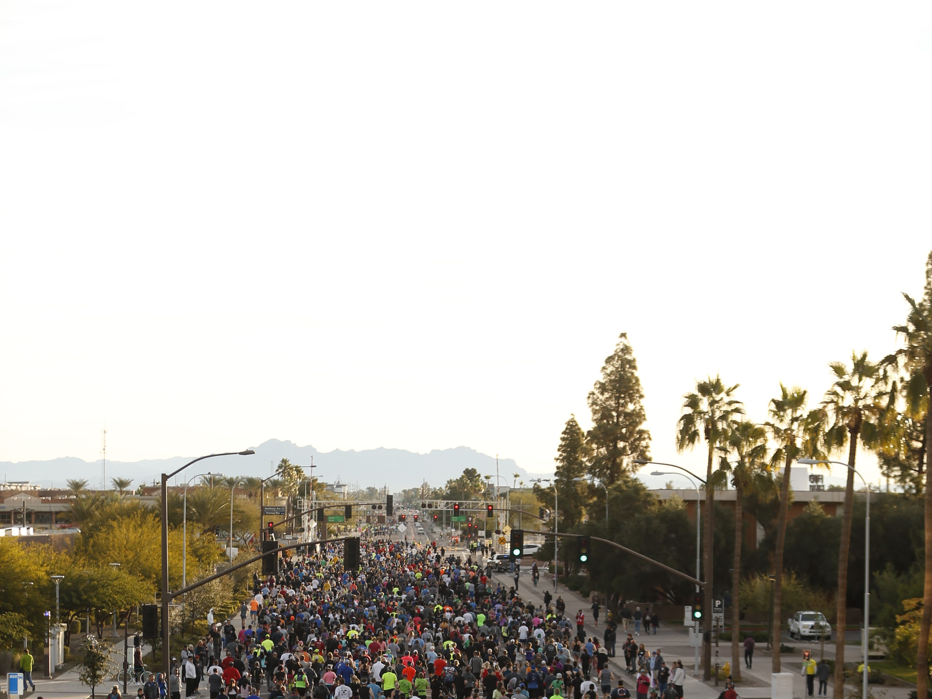 People make their way down University Street during the Rock 'N' Roll half-marathon in Tempe on Jan. 20, 2019.