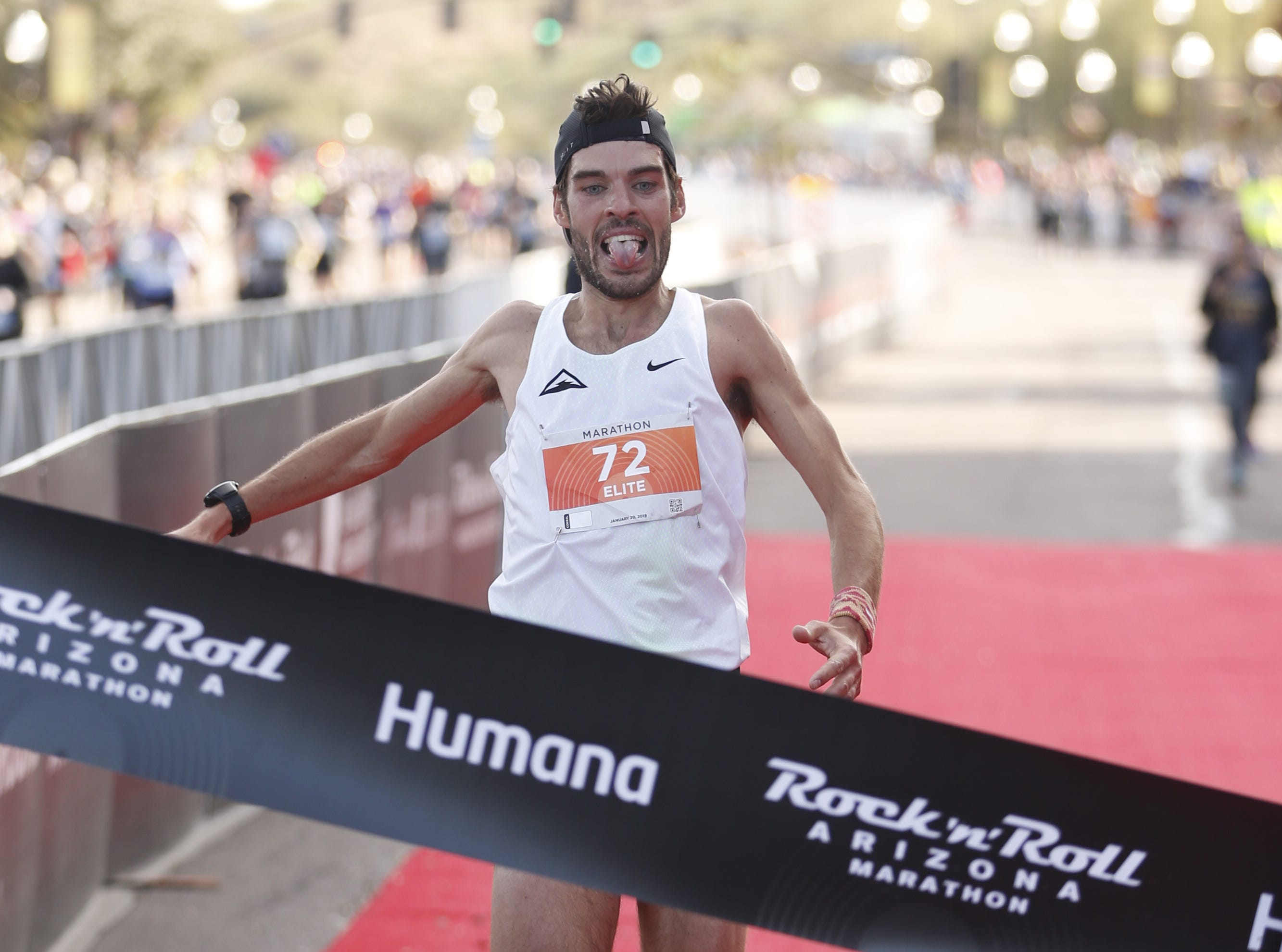 Chris Mocko (72) comes across the finish line to win the Rock 'N' Roll marathon in Tempe on Jan. 20, 2019.
