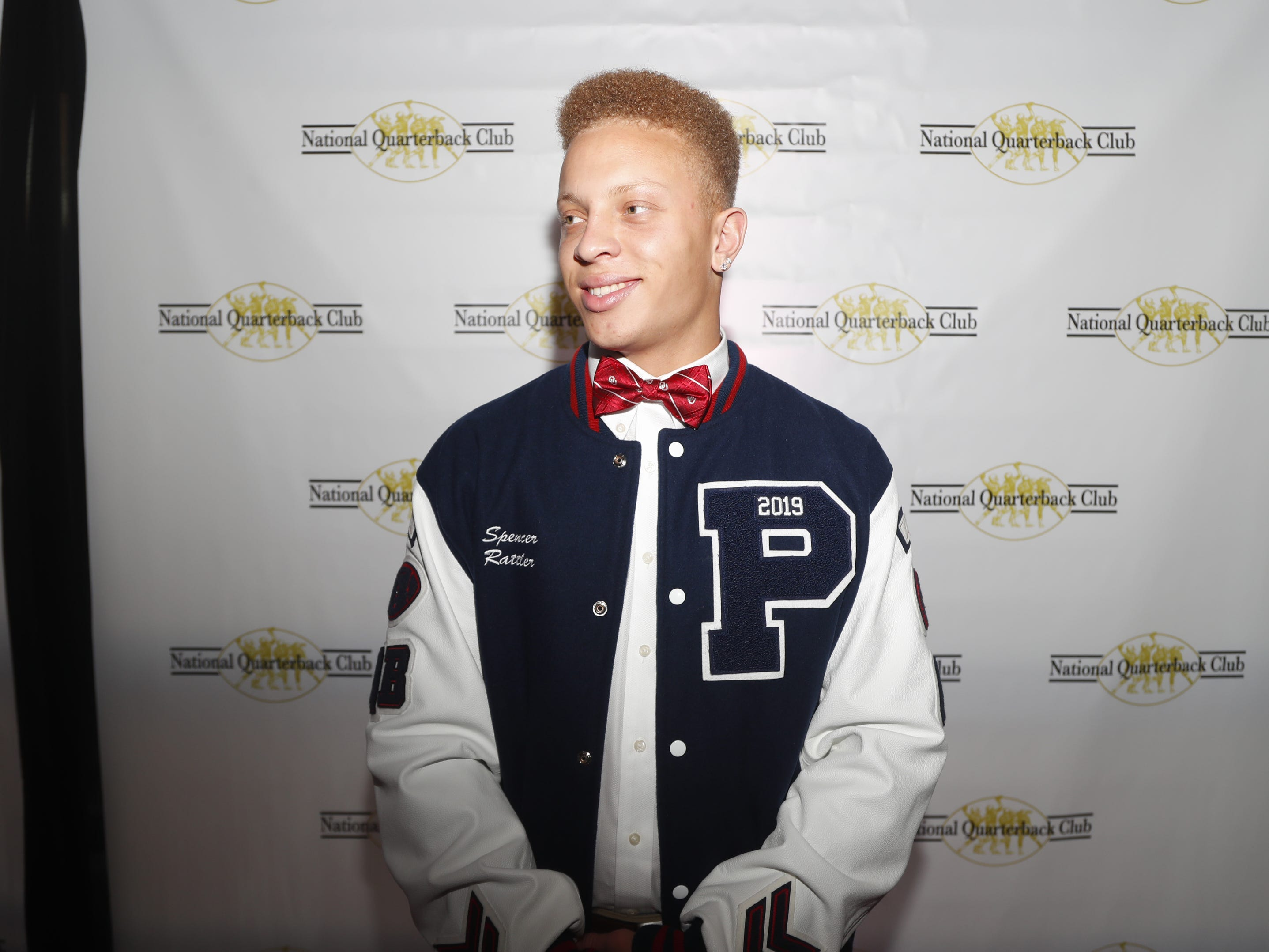 Pinnacle quarterback Spencer Rattler poses for pictures before the National Quarterback Club Awards Dinner & Hall of Fame Induction Ceremony The Scottsdale Resort at McCormick Ranch in Scottsdale, Ariz. on January 19, 2019.