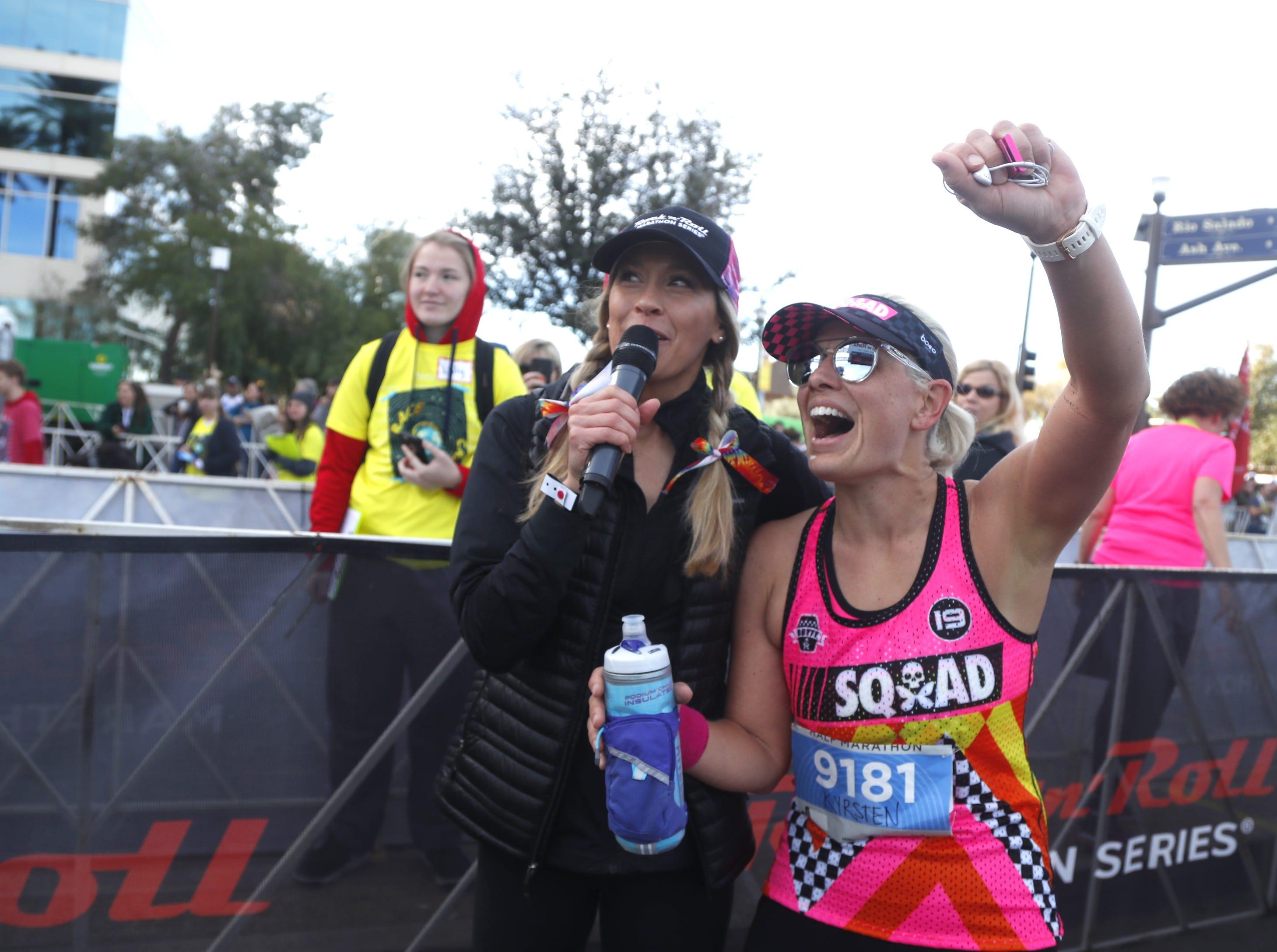 Sen. Kyrsten Sinema celebrates with emcee Ann Wessling after Sinema finished the Rock 'N' Roll half-marathon in Tempe on Jan. 20, 2019.