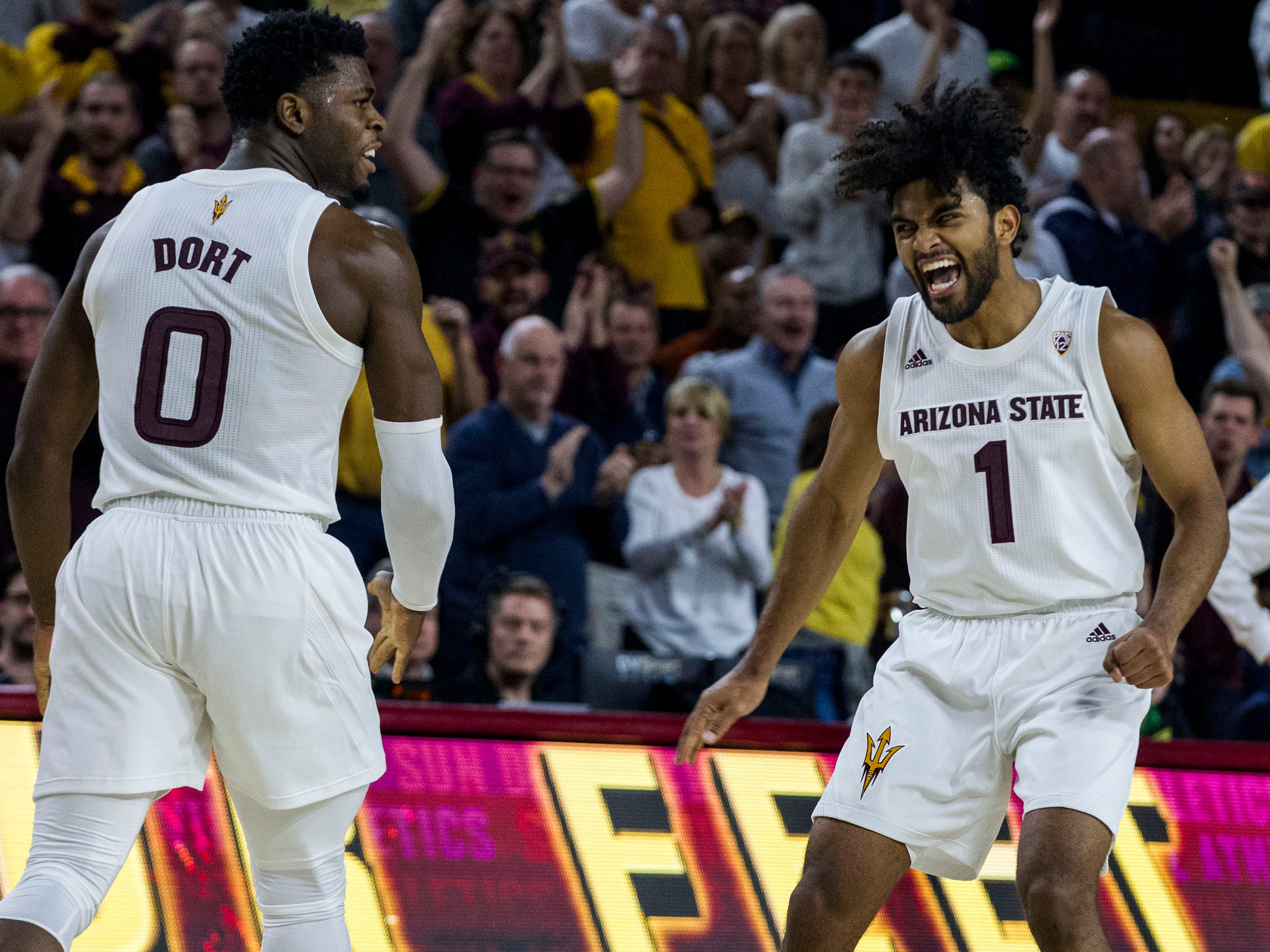 Arizona State's Luguentz Dort (0) and Remy Martin (1) celebrate during the second half against Oregon on Saturday, Jan. 19, 2019, in Tempe, Ariz. Arizona State won 78-64. (AP Photo/Darryl Webb)