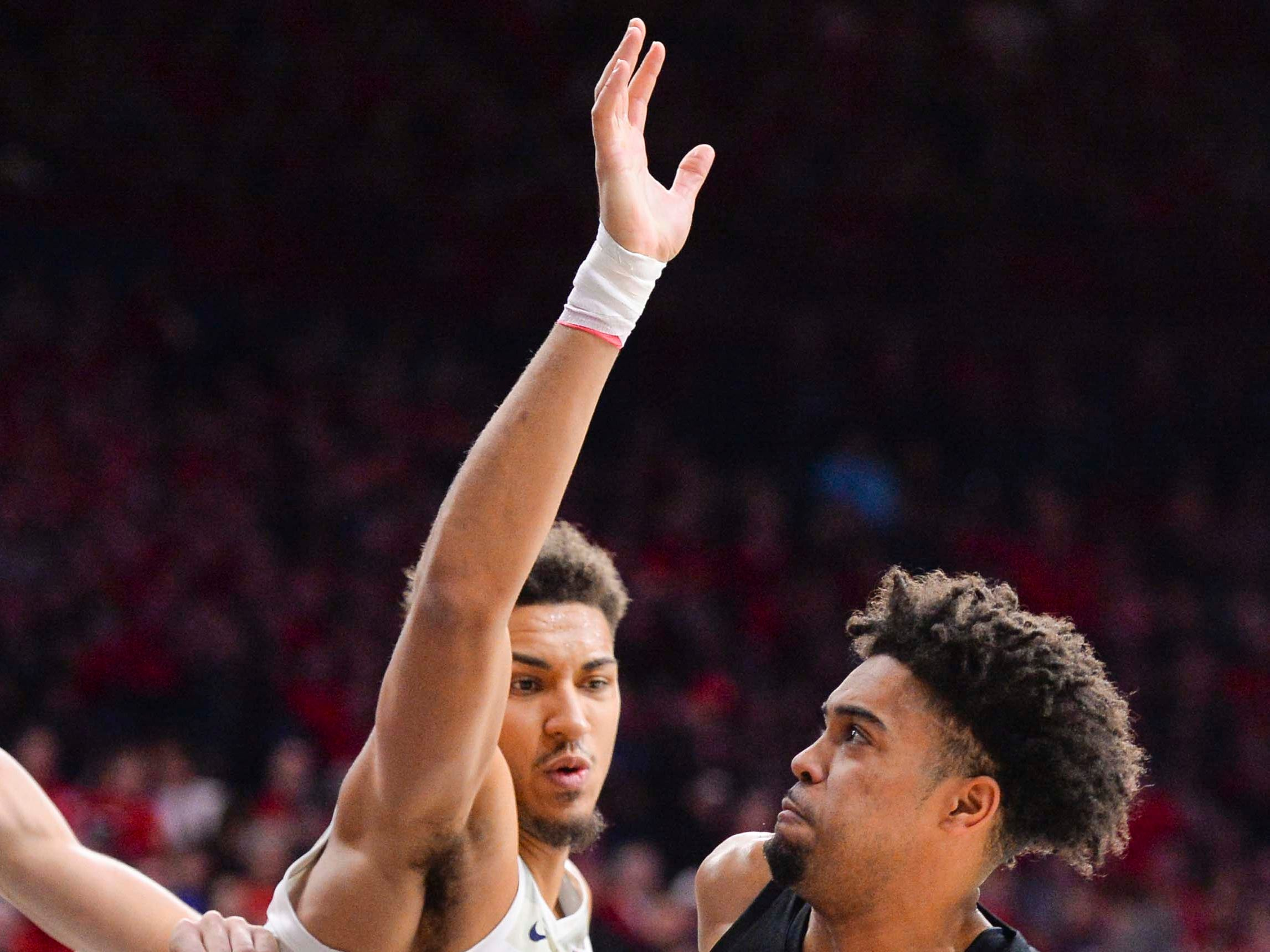 Jan 19, 2019; Tucson, AZ, USA; Oregon State Beavers guard Stephen Thompson Jr. (1) attempts to shoot as Arizona Wildcats center Chase Jeter (4) defends during the first half at McKale Center. Mandatory Credit: Casey Sapio-USA TODAY Sports